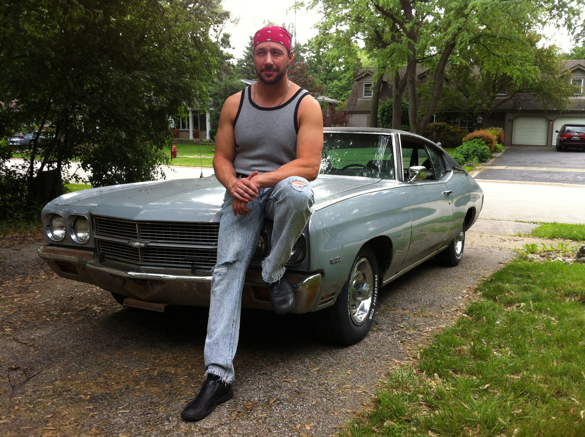 Tony Lee hanging out on his badass Chevelle.
