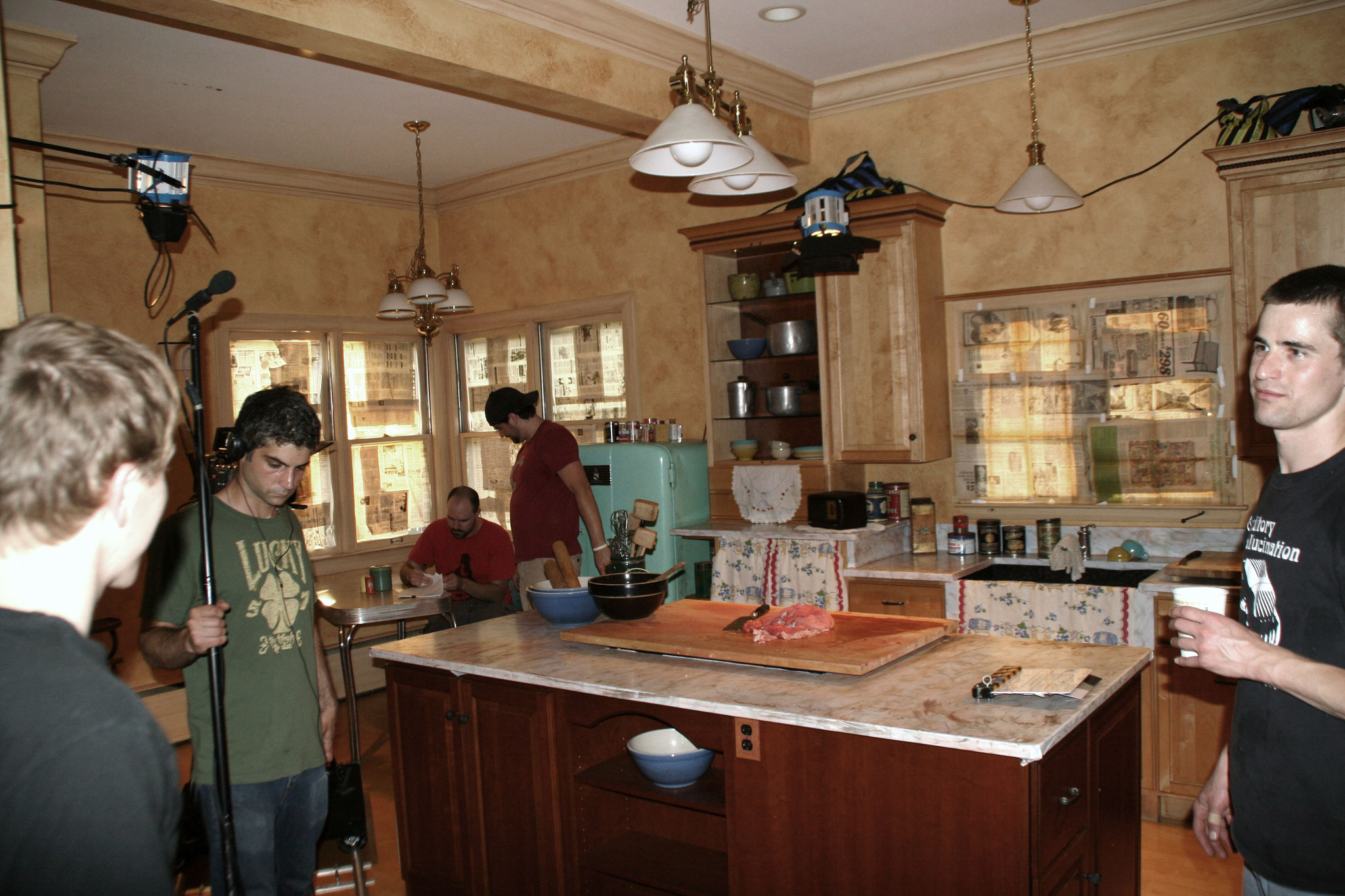 The team setting up a sequence in the kitchen of Grandma O'Malley's house.