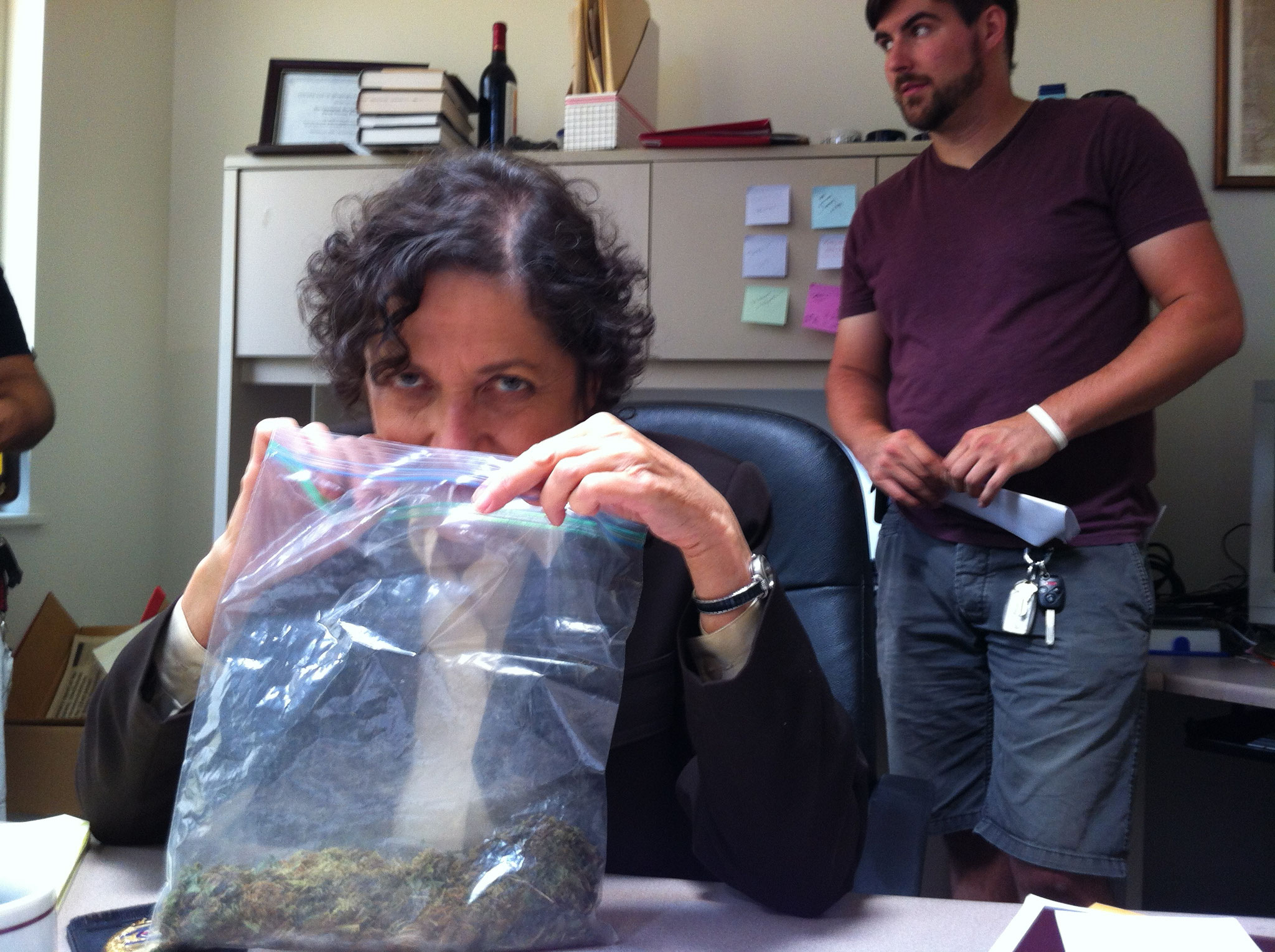 Director Les (Joette Waters) smellin' the goods in her office as the crew sets up a shot.