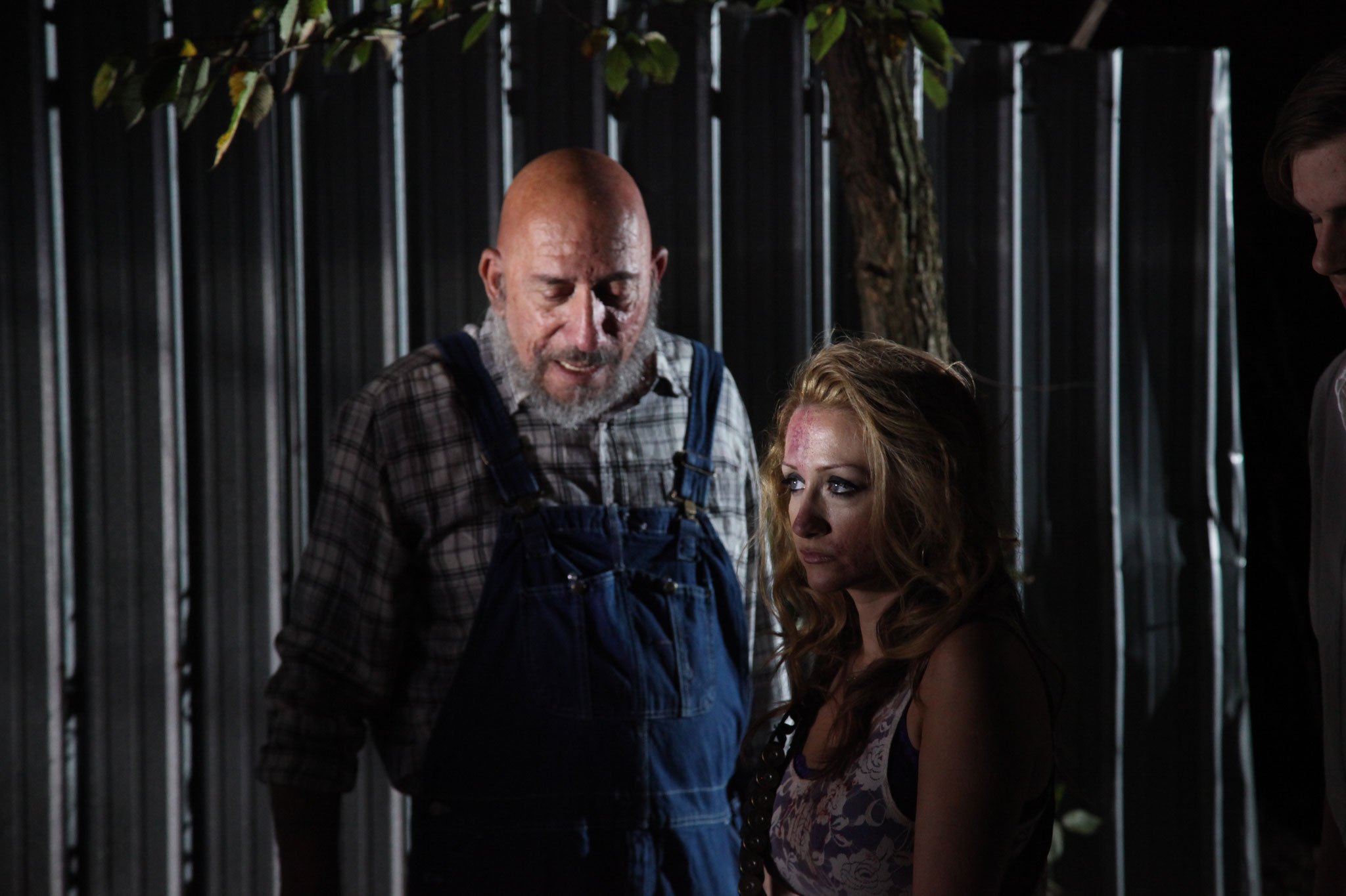 Sid Haig and Fiona Domenica taking a moment to breath between takes.