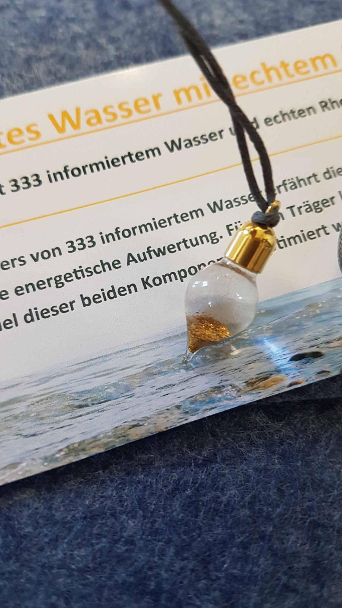 333 infomiertes Wasser mit echten Rheingoldflittern in Form eines Tropfens