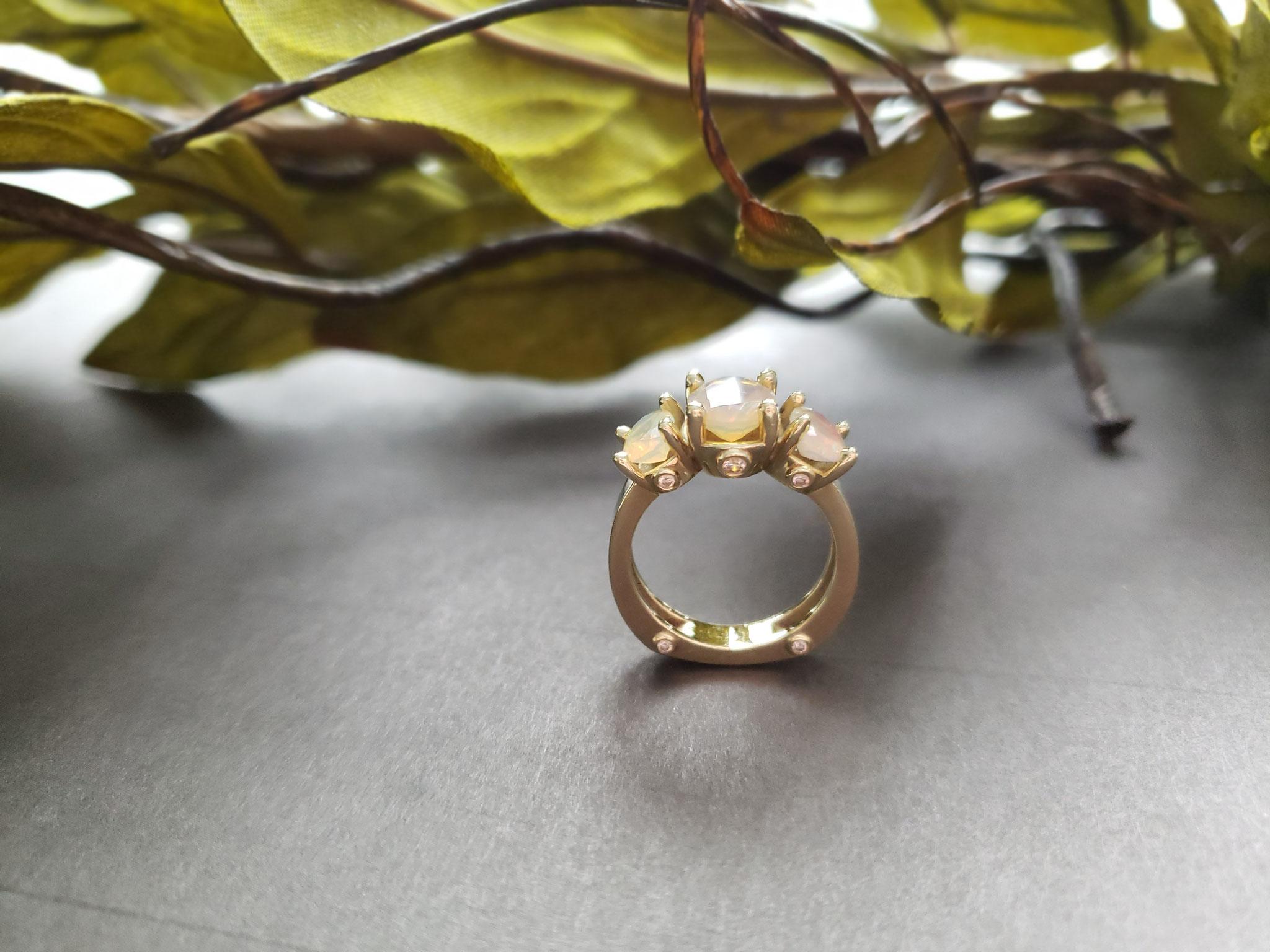 3 stone ethiopian opal ring in 14K green gold