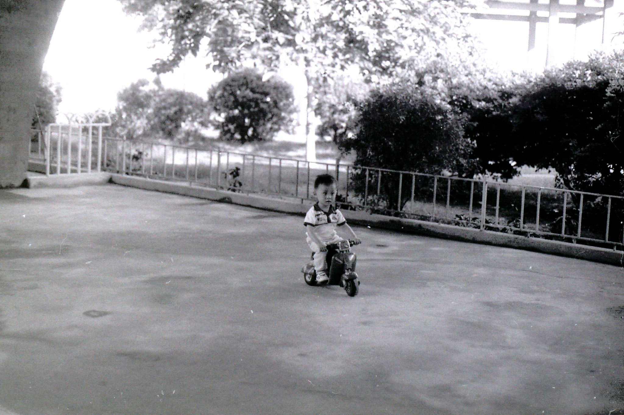 17/5/1989: 22: Guangzhou boy on miniature motor bike