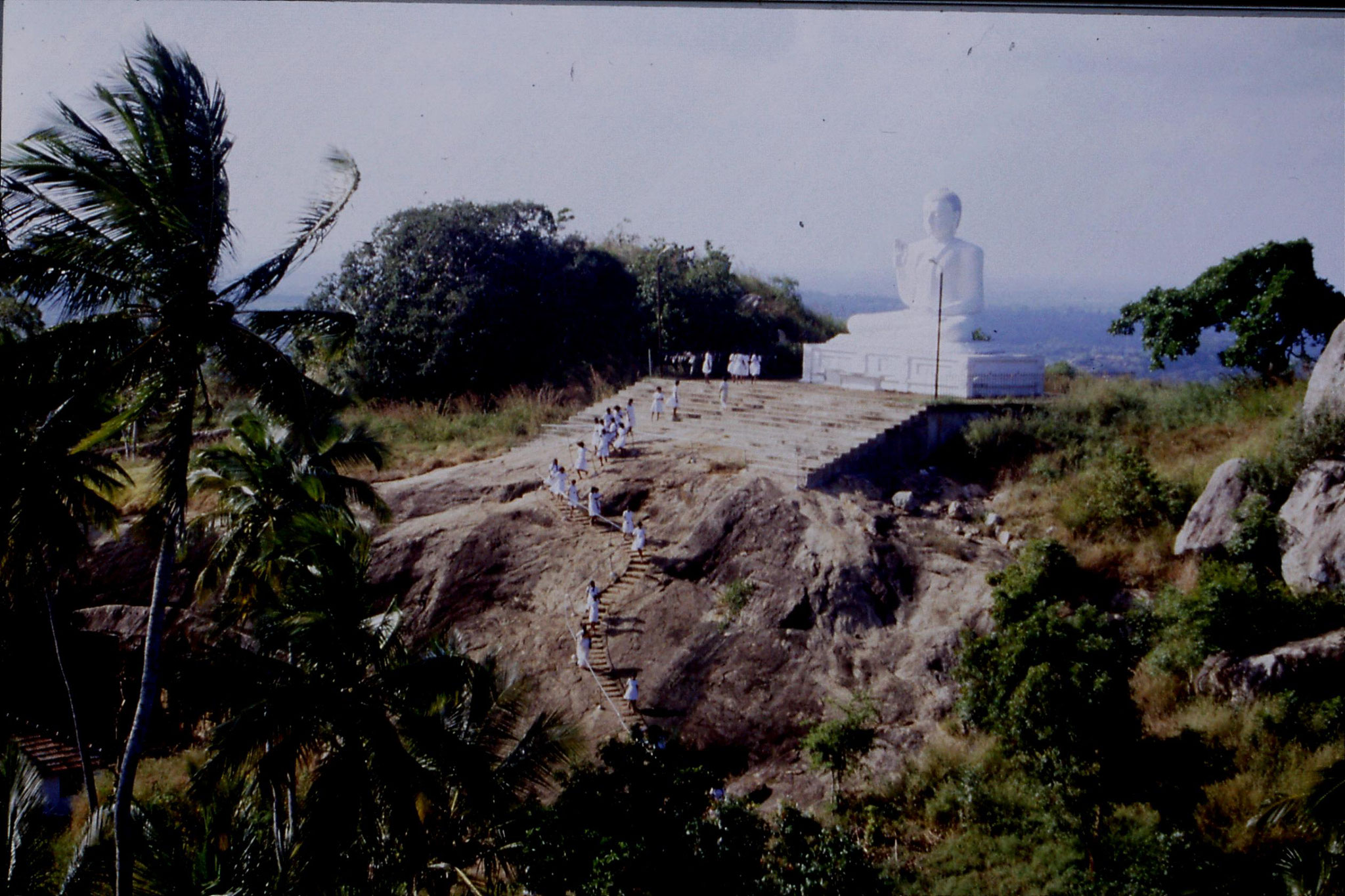 103/3: 8/2/1990 Buddha statue and school girls at Mihintale
