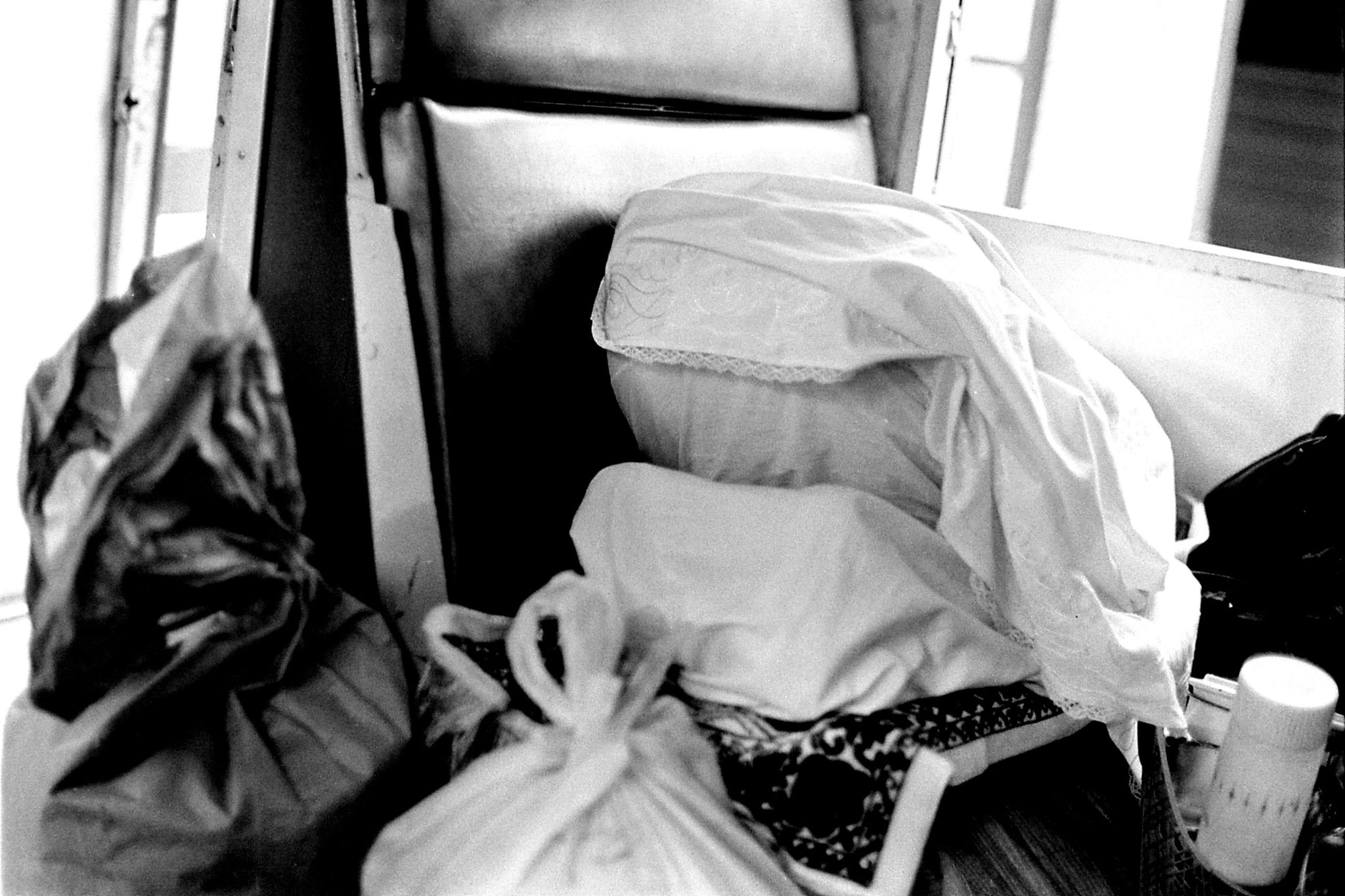 21/6/1990: 34: woman praying on train