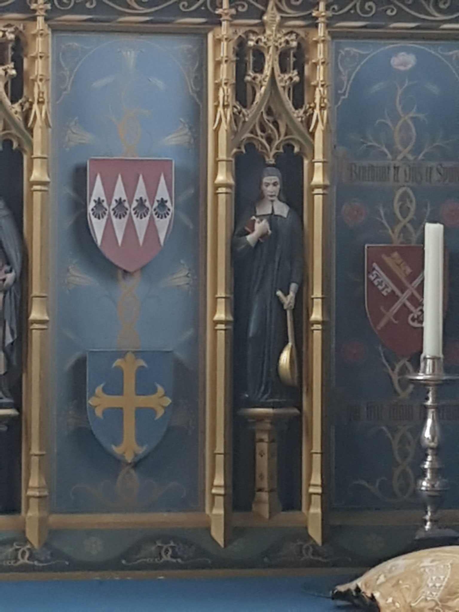 George Herbert with mandolin on the Neo-Gothic 1930s reredos