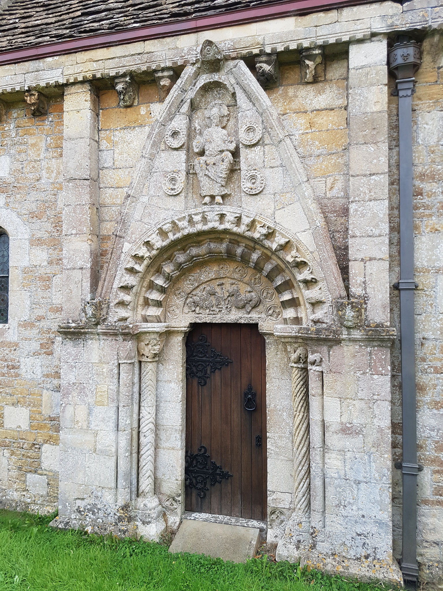 North doorway with tympanum of two creatures eating from the Tree of Life