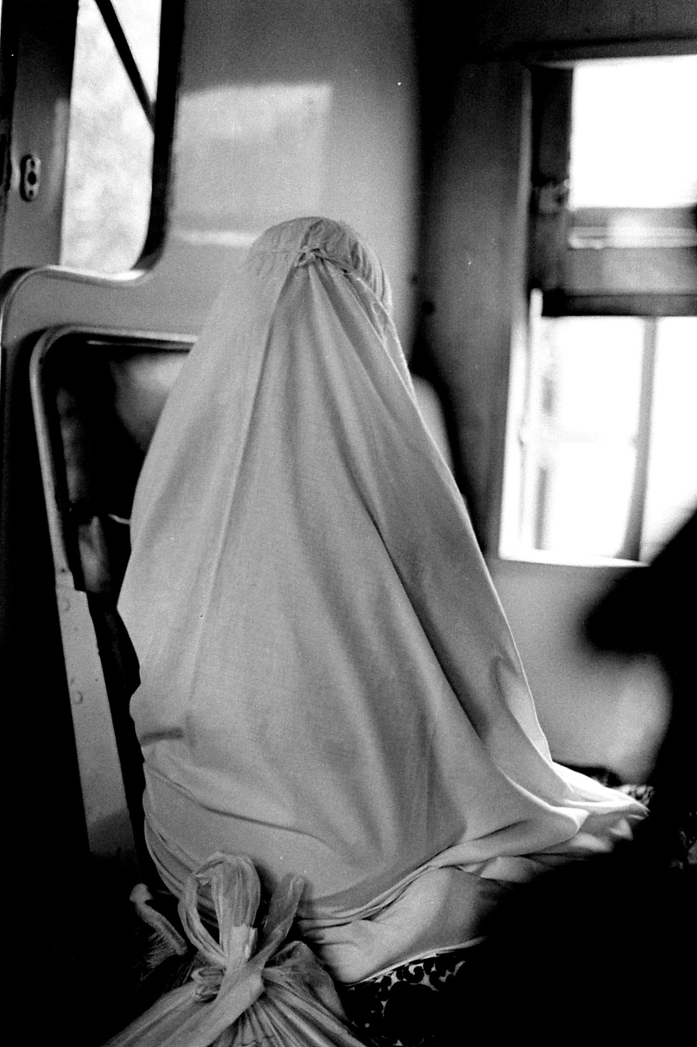21/6/1990: 33: woman praying on train