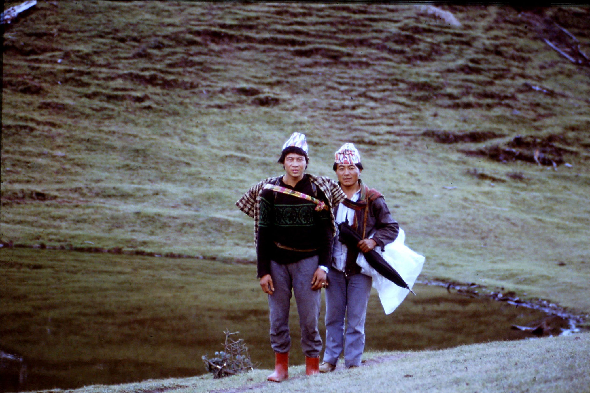 7/5/1990: 17: two Nepalis by lake