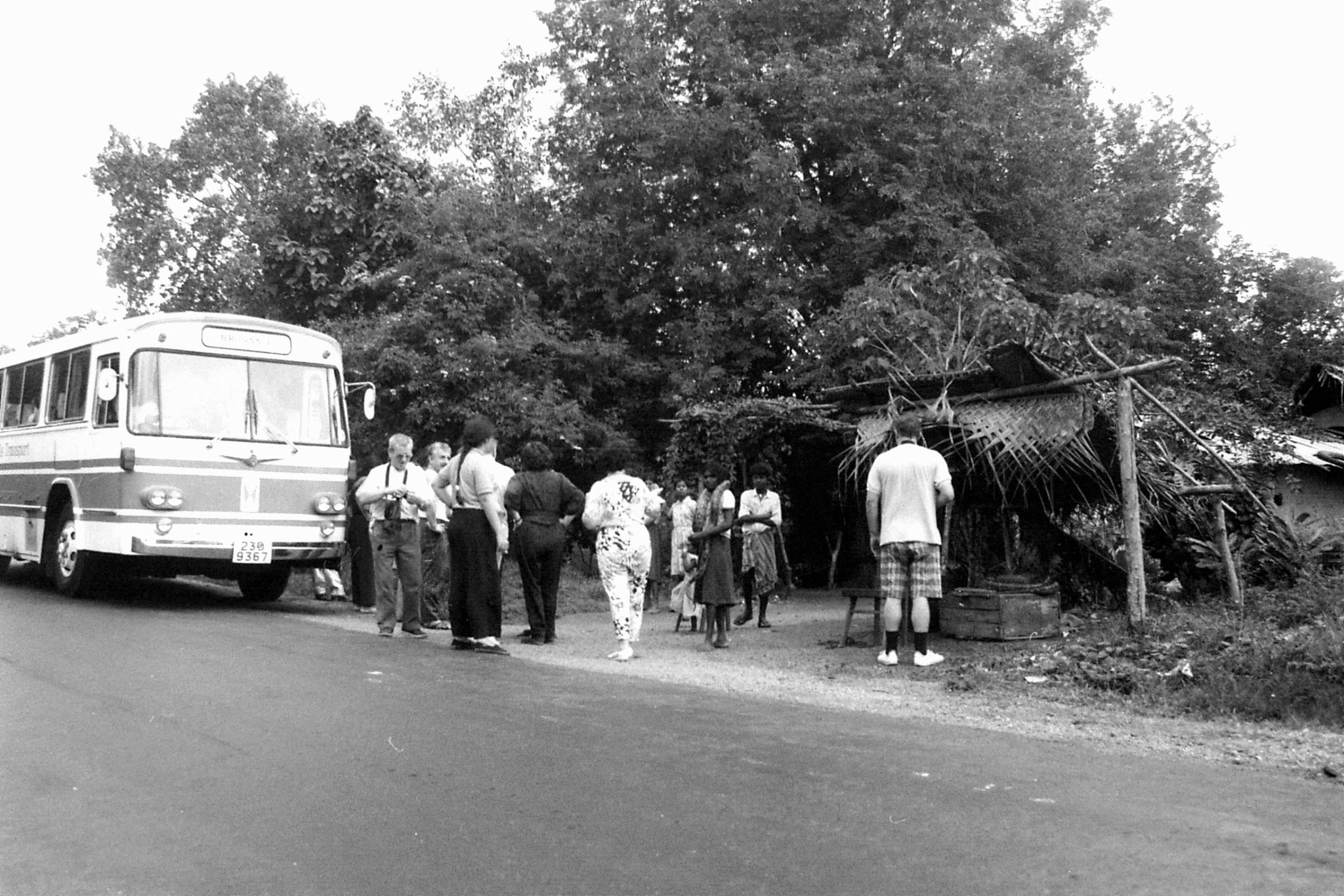 7/2/90: 9: tourists with snake between Sigiriya and Polonnaruwa