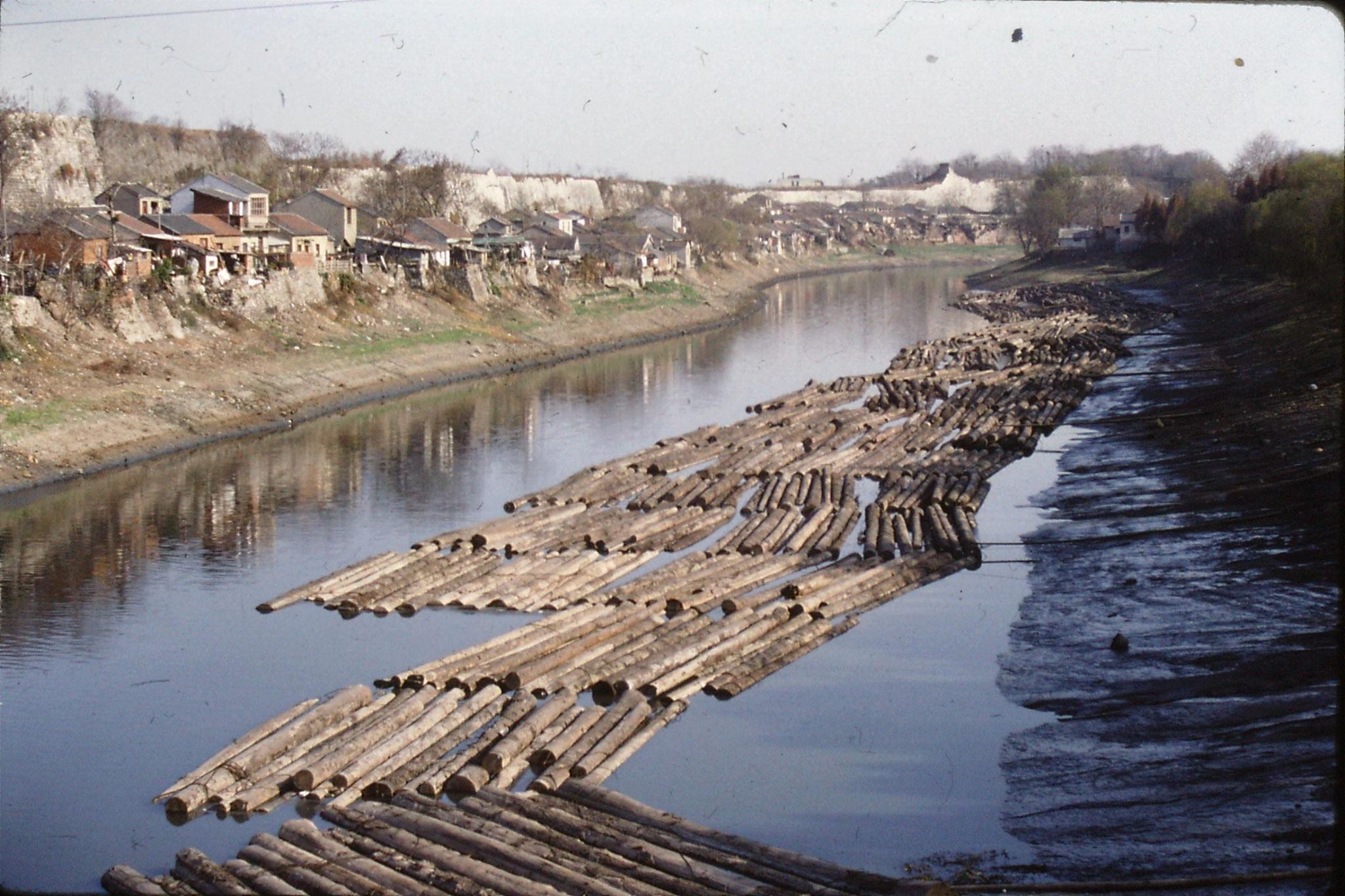 11/12/1988: 29: Nanjing logs in canal and city wall