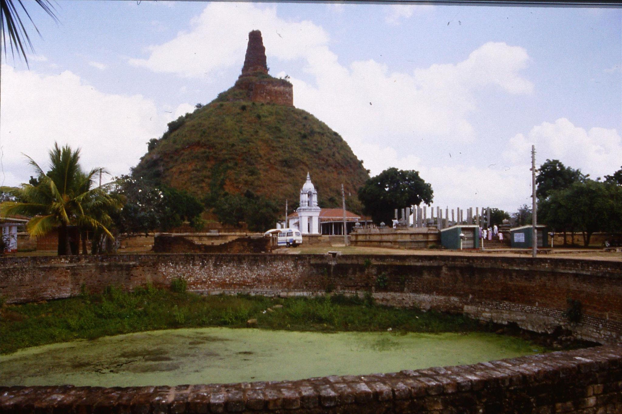 103/10: 9/2/1990 Anuradhapura Abhayagiri dagoba overgrown (245ft)
