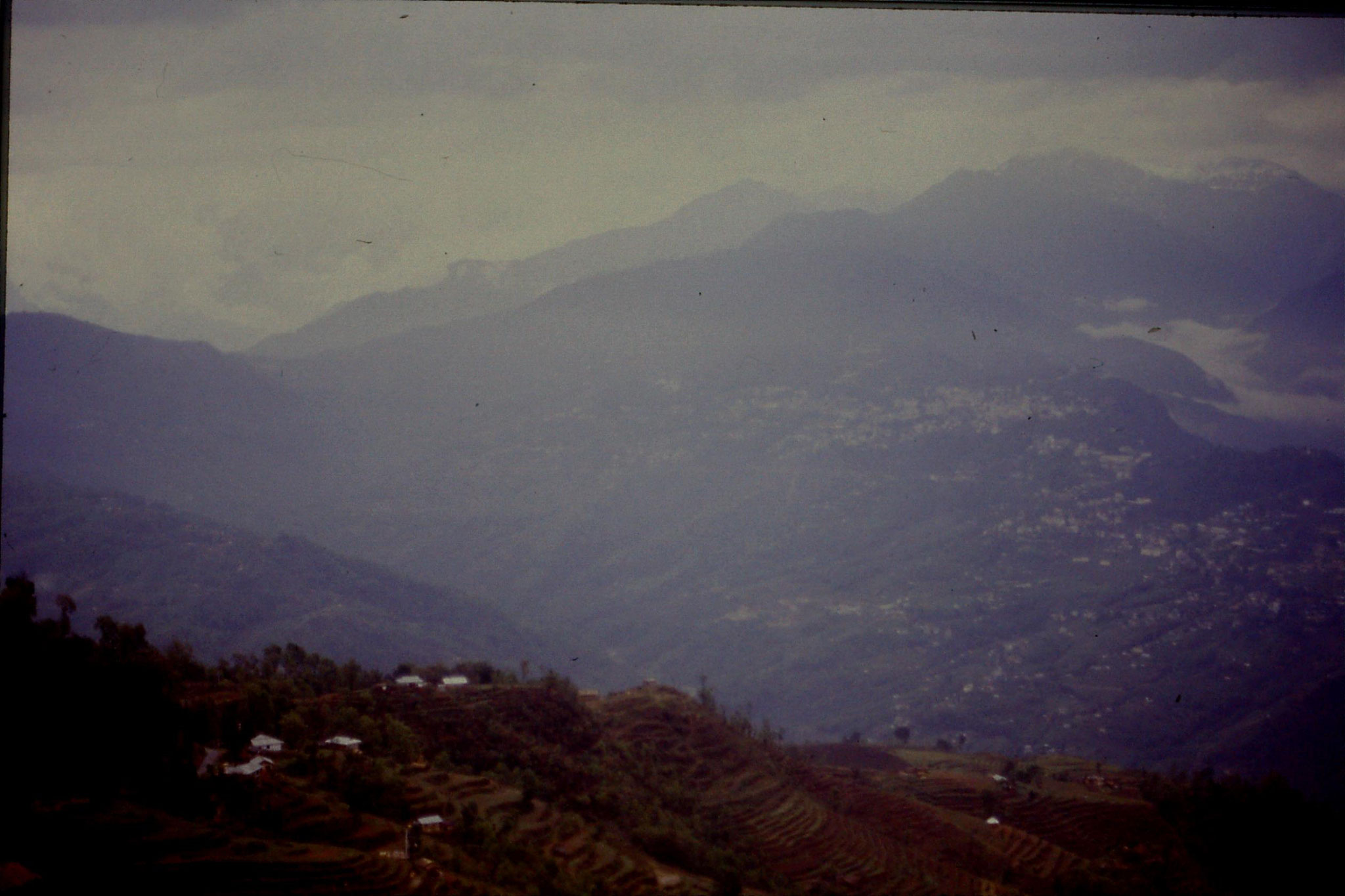 115/10: 23/4/1990 Rumtek - view of Gangtok and terrain