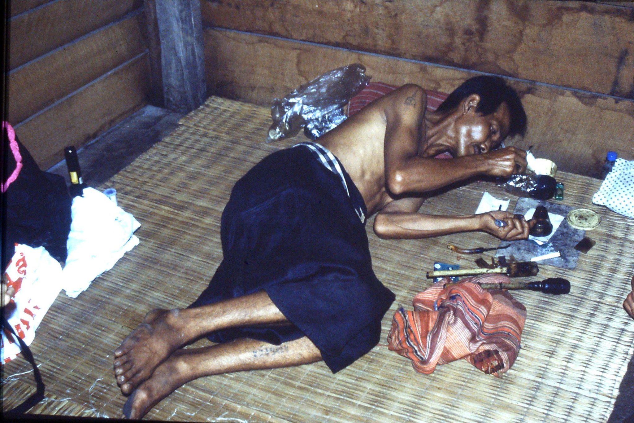 12/6/1990: 36: Trek - Hue Kom Karen village, man smoking opium