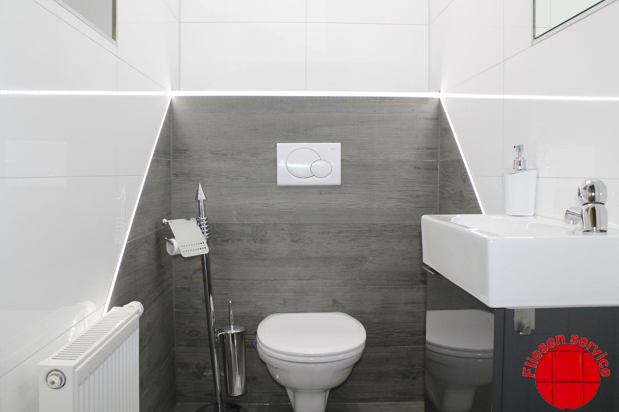 WC mit Schräge und LED Beleuchtung