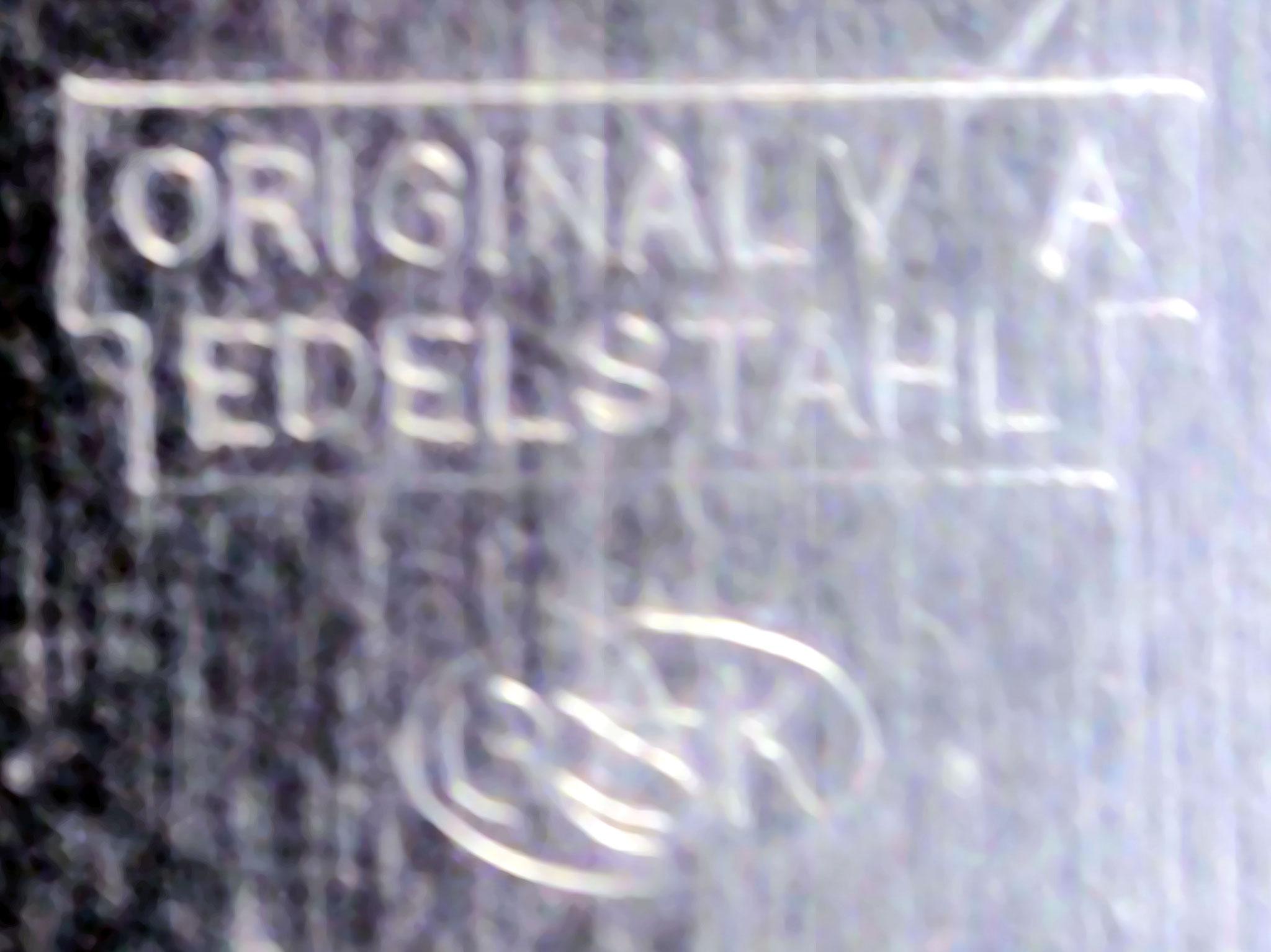 ovales Firmenzeichen der Gebr. Kuttroff Pforzheim