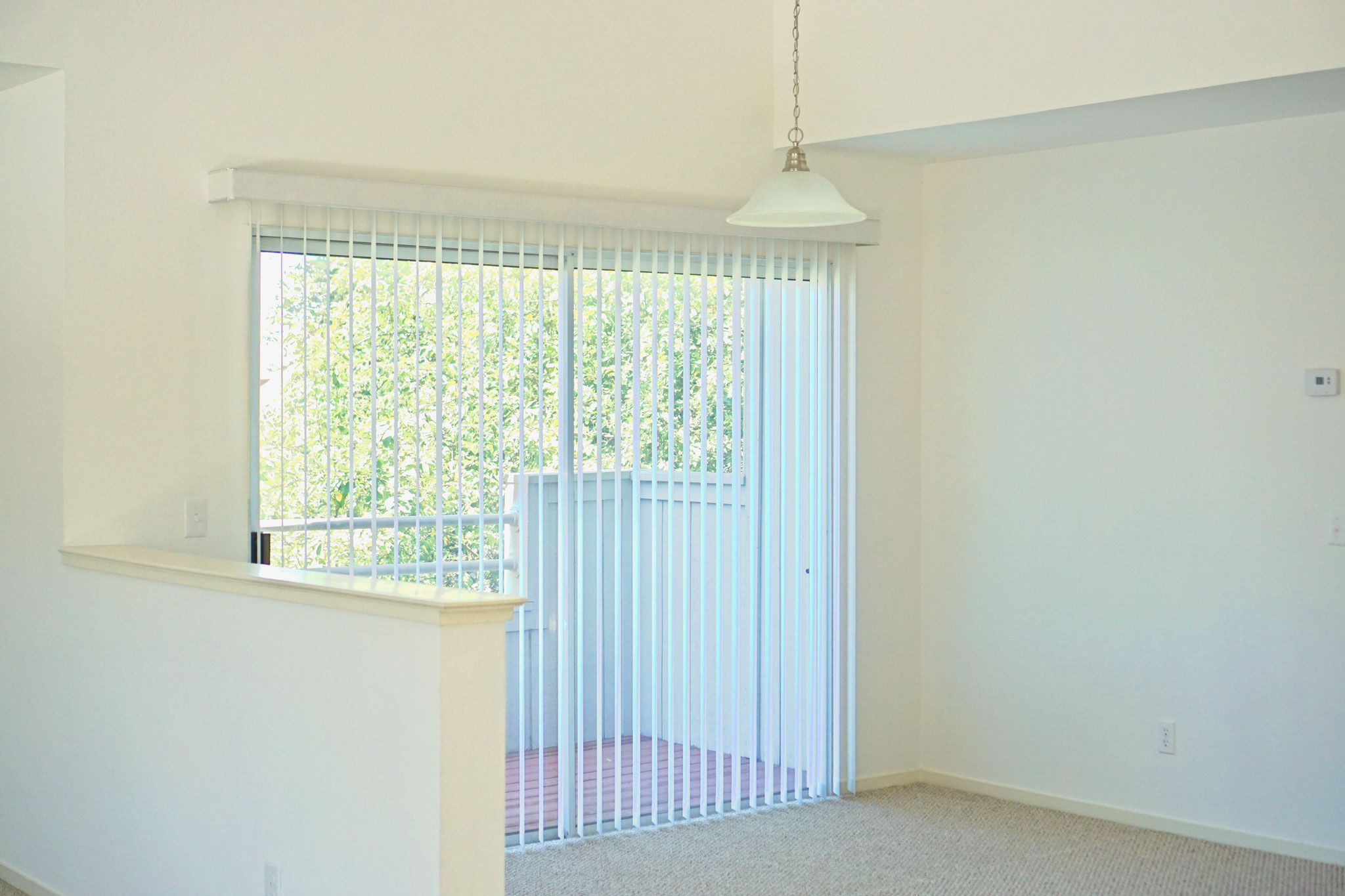 dining room with sliding doors to balcony