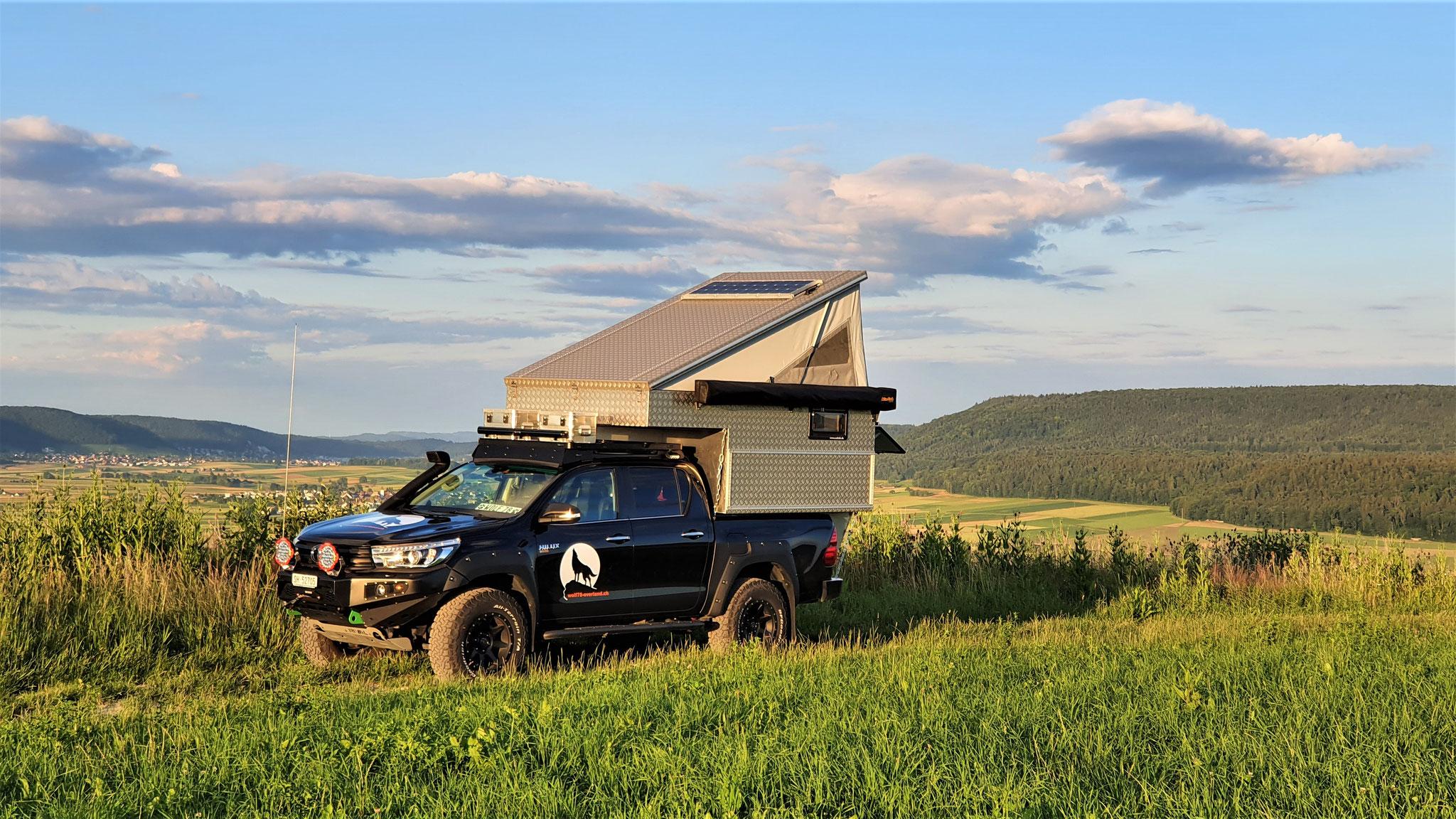 """Exkab Defender 130 Wohnkabine Toyota Hilux Pickup camper Revo 2017 2.4 #ProjektBlackwolf truckcamper  4x4 Frontrunner Rocksliders Roofrack Rival skidplate  bfgoodrich 285/70R17 33"""" Tires TJM Sknorkel offroad Tacoma expedition overland wolf78-overland.ch"""