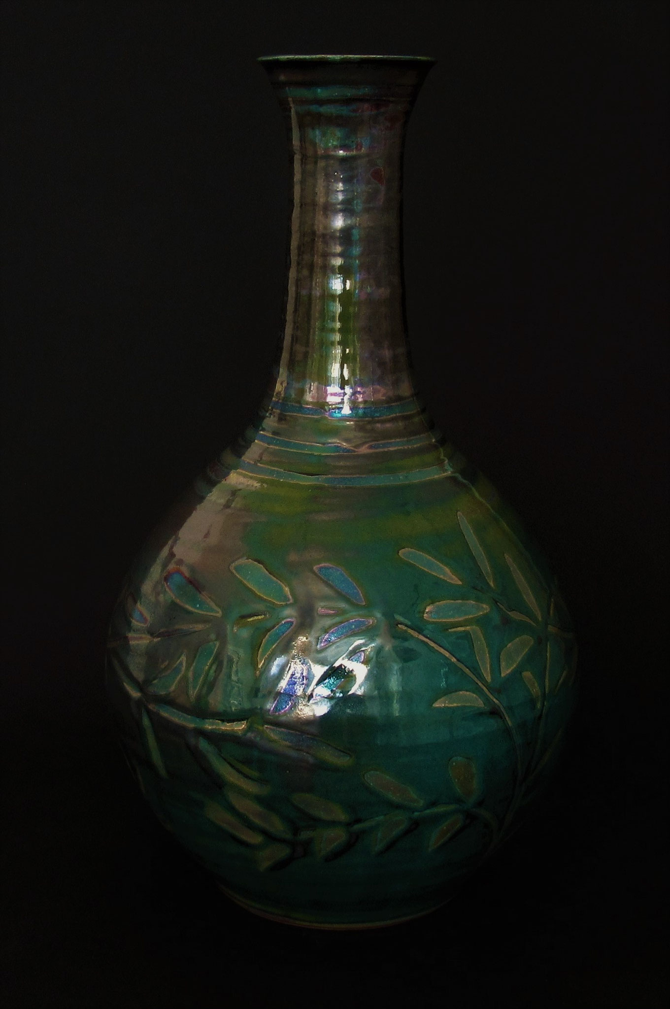 Large bottle form. Rich green/pewter with subtle, green-silver lustre.£135.