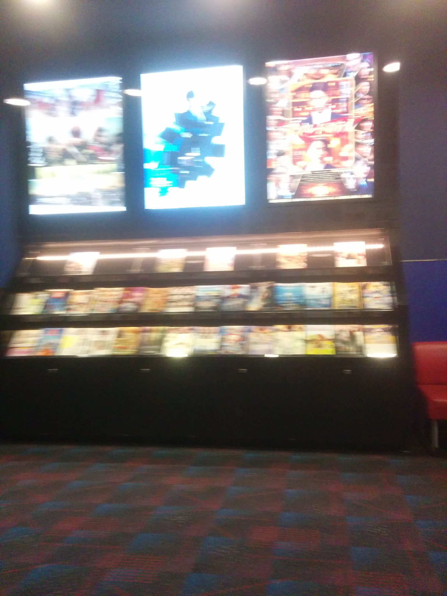 At the cinema (adverts and magazines about movies)
