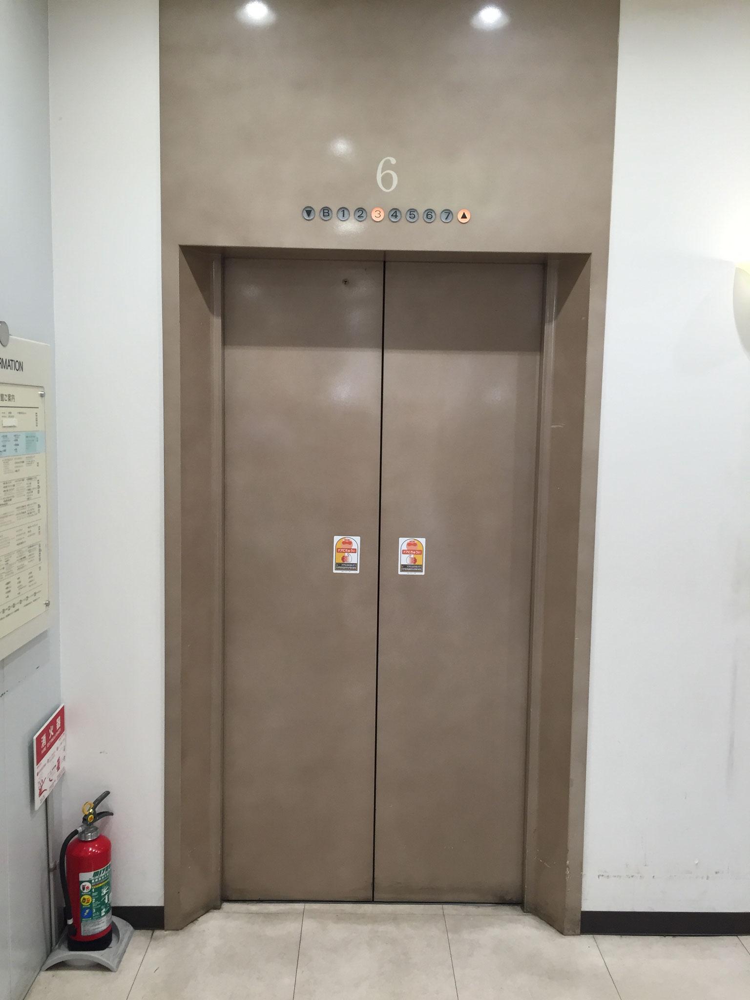 エレベーターで『6階』までお上がりください