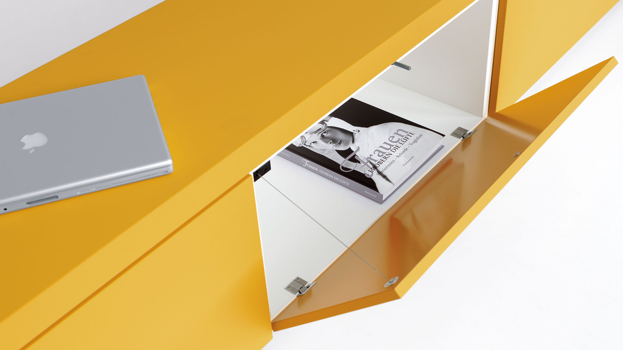 The bureau-style fold-down front opens from top to bottom and is useful for placing things on temporarily.