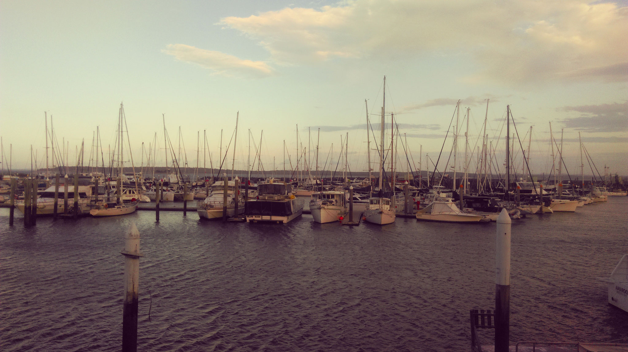 The Hervey Bay harbour at sunset before boarding the ferry to the island..