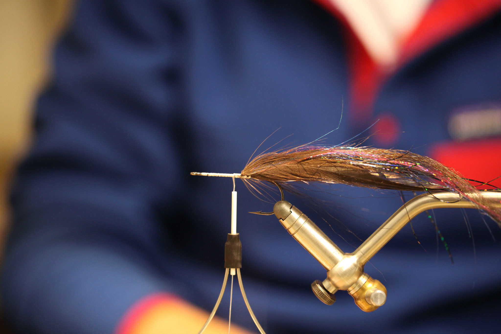 Tie in one hackle feather on each side