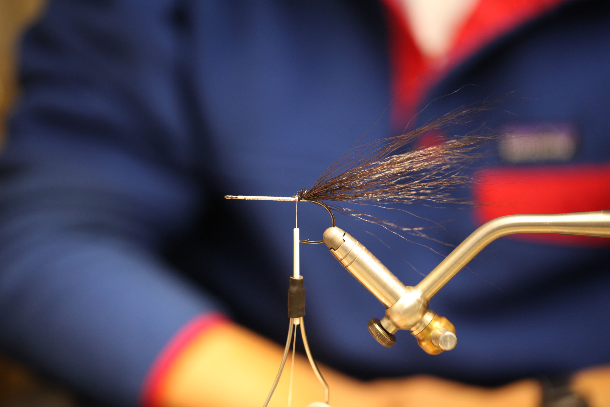 Start with a small bundle of bucktail for a tail