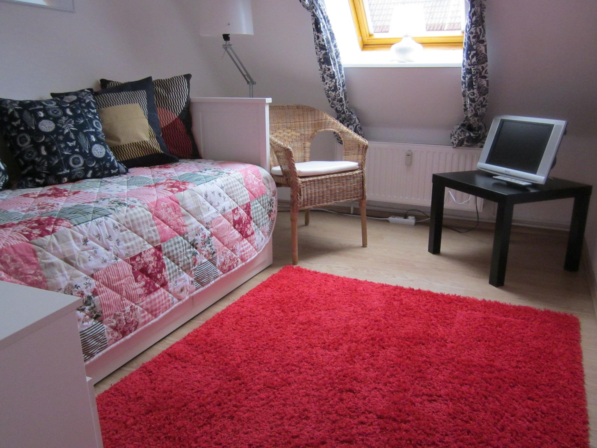 Zimmer mit einem Bett