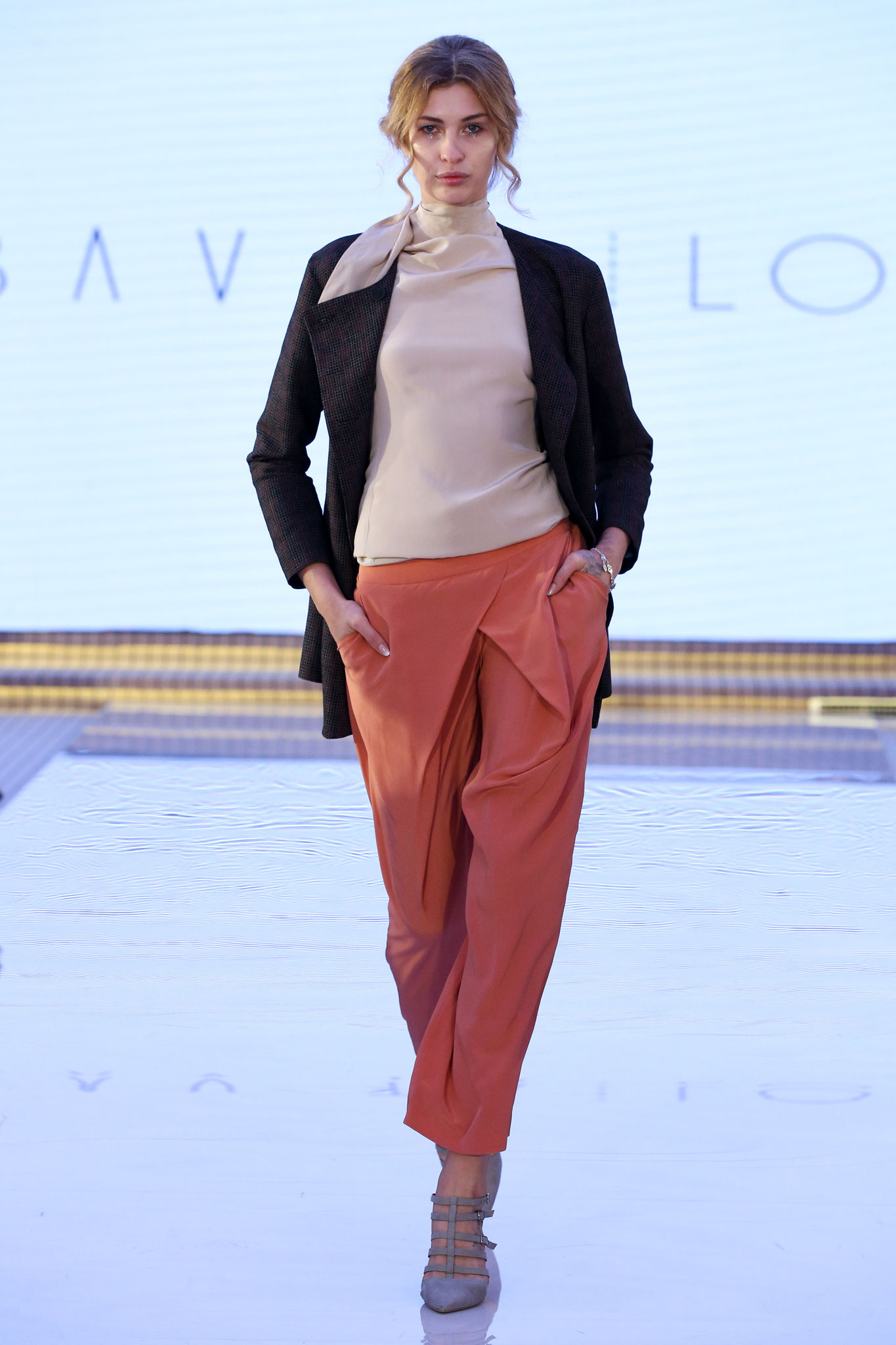 "A frame of the catwalk, showing  a beautiful and completely sustainable outfit by ""Bav Tailor"" collection. @bavtailor"
