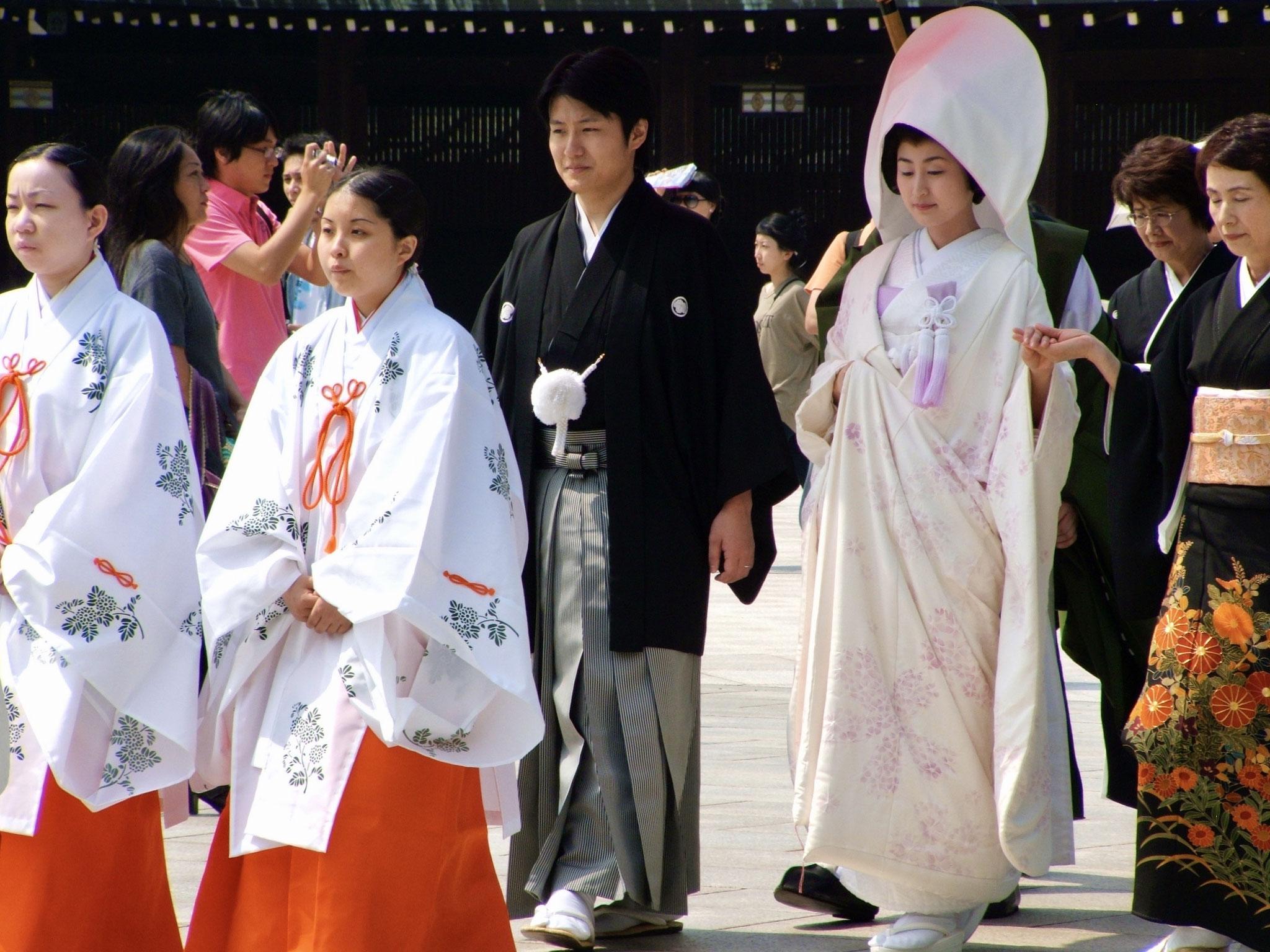 Shinto wedding couple preceded by Shinto maidens, Tokyo