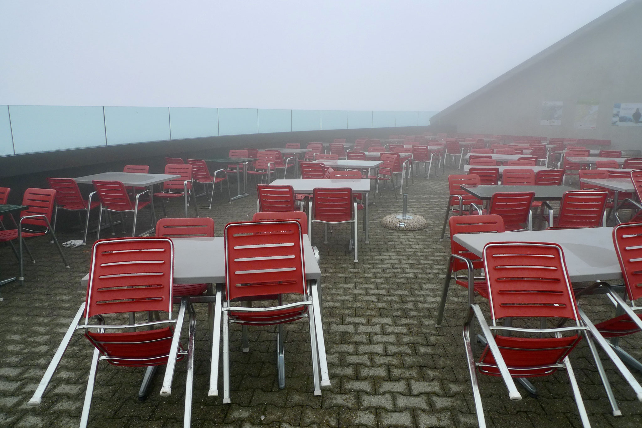 Red chairs in mist, Lucerne