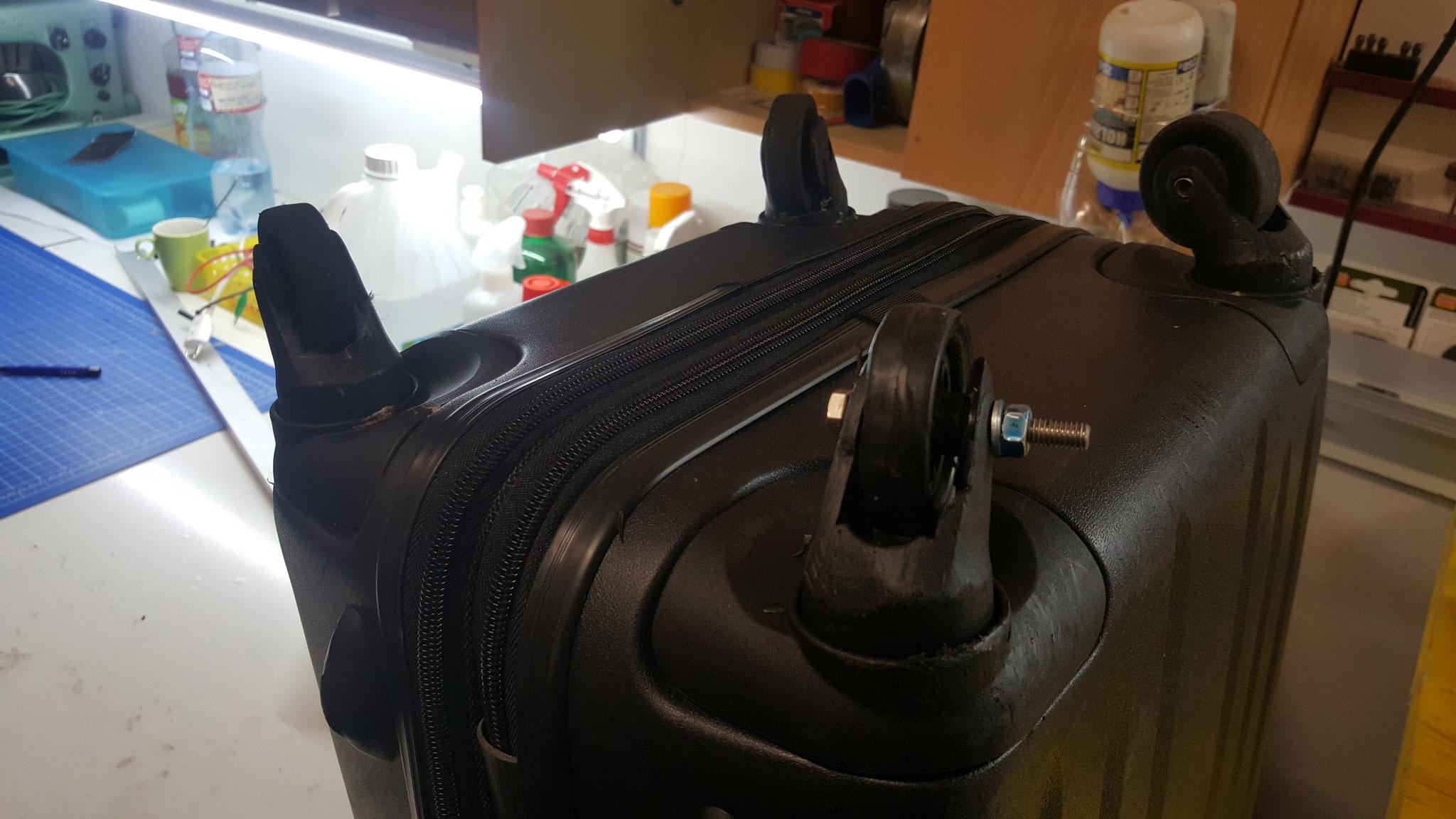 Räder an Koffer reparieren