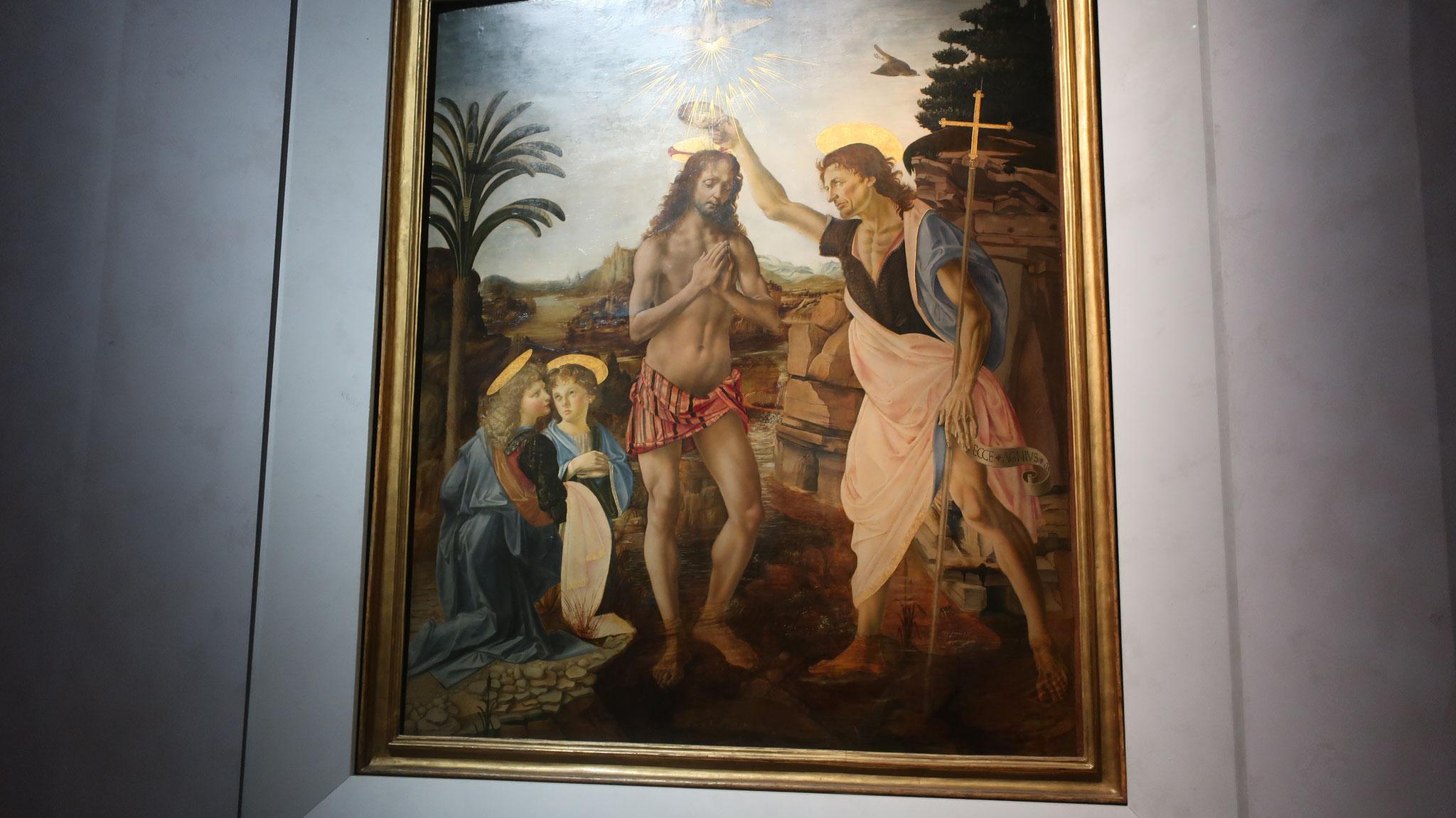 キリストの洗礼。15世紀、ヴェロッキオ(レオナルド・ダ・ヴィンチの師)作。弟子のダ・ヴィンチに左の天使と背景を描かせた所、 自分を上回ると感じた師のヴェロッキオは、引退しました。