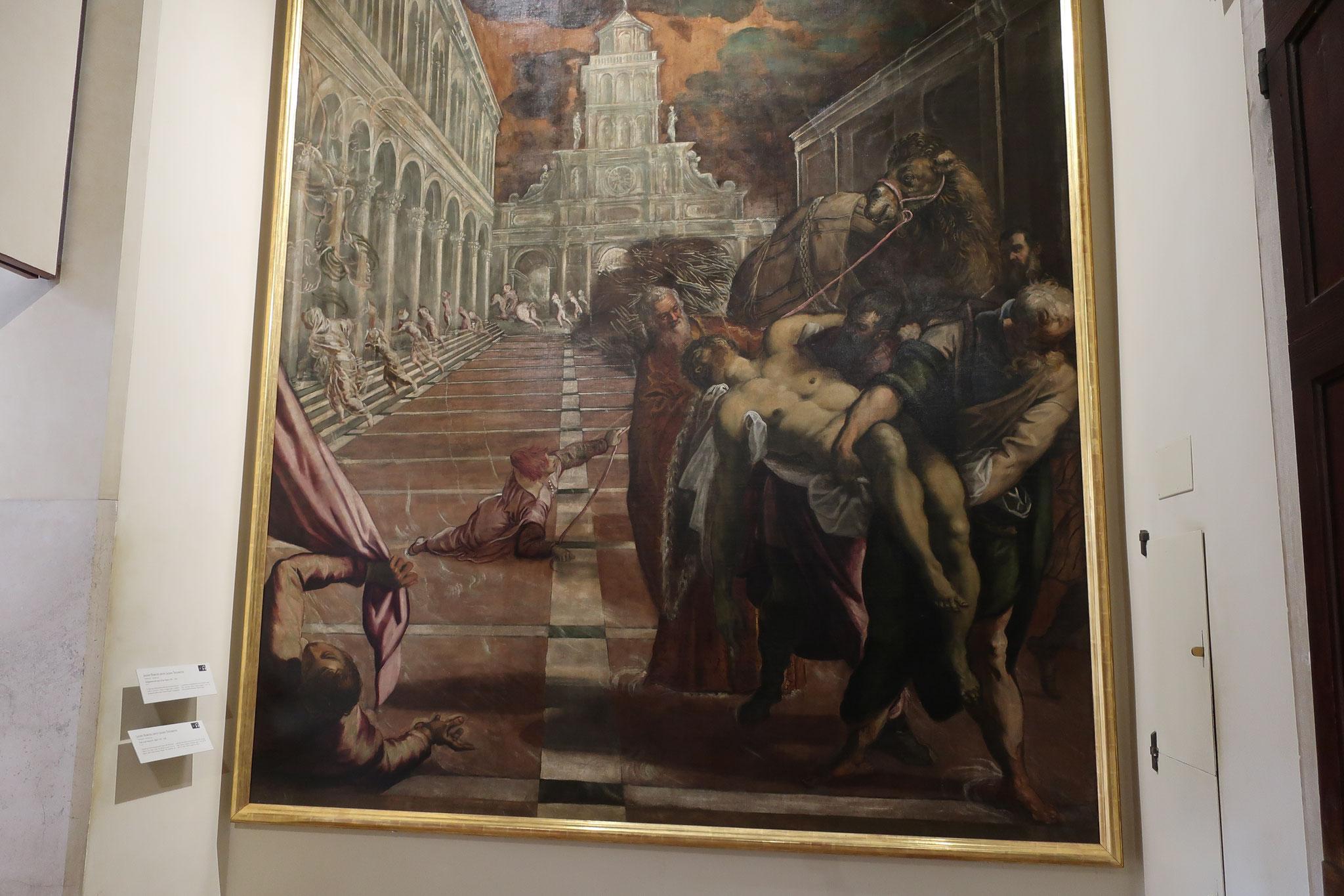 「聖マルコ遺体の窃取」ティントレット 作。ヴェネツィア商人2人がエジプトのアレキサンドリアから、アラブ人を騙して聖人マルコの遺体をヴェネツィアに運んだ故事を描いています。