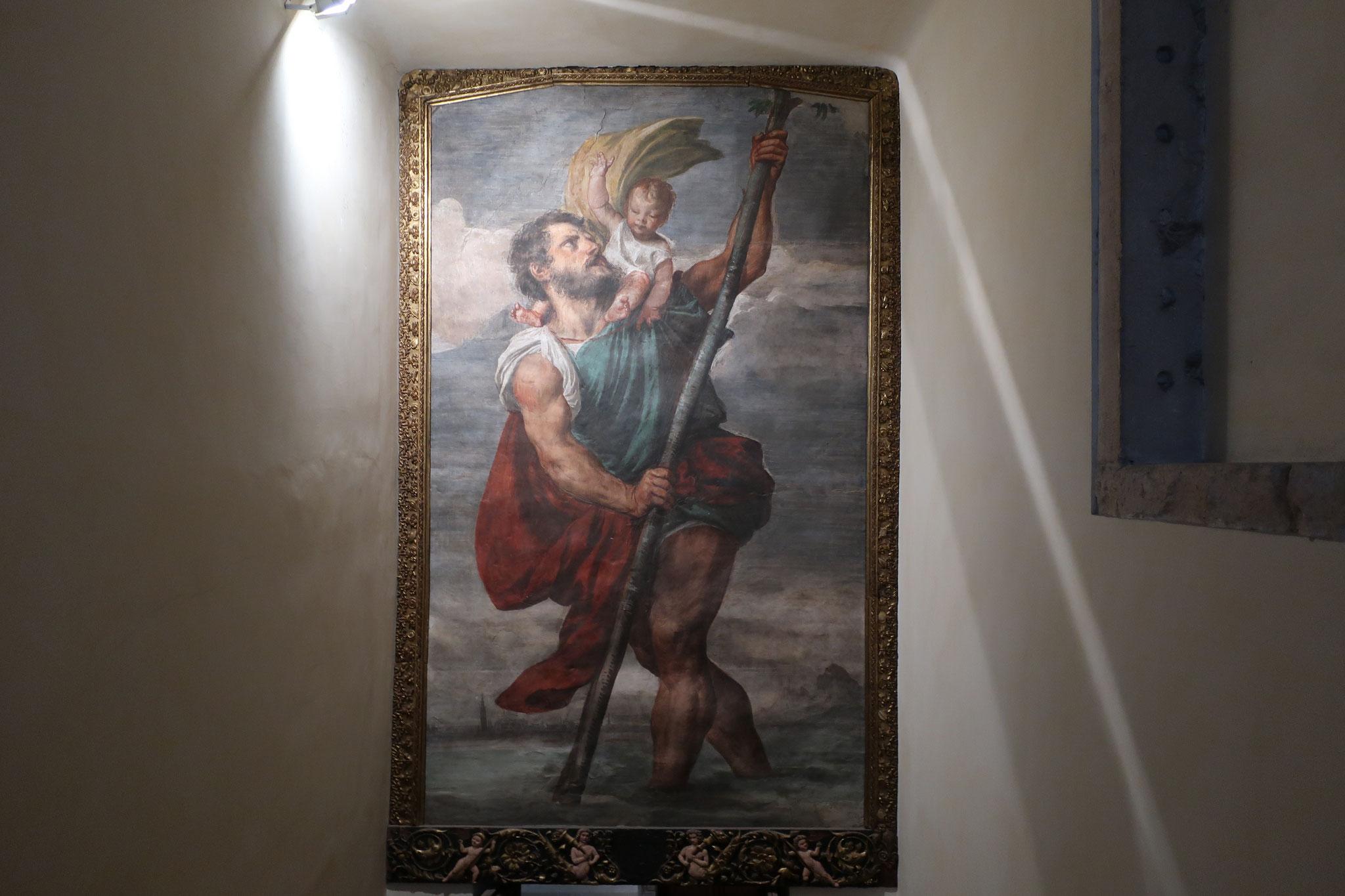 子供に化身したイエス・キリストを担いで川を渡る聖クリストフォーロ(「キリストを運ぶ」という意味)。ティツィアーノのフレスコ画。