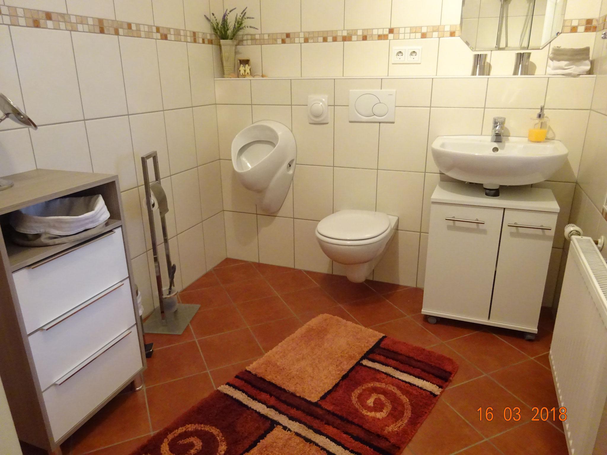 Bad mit Urinal