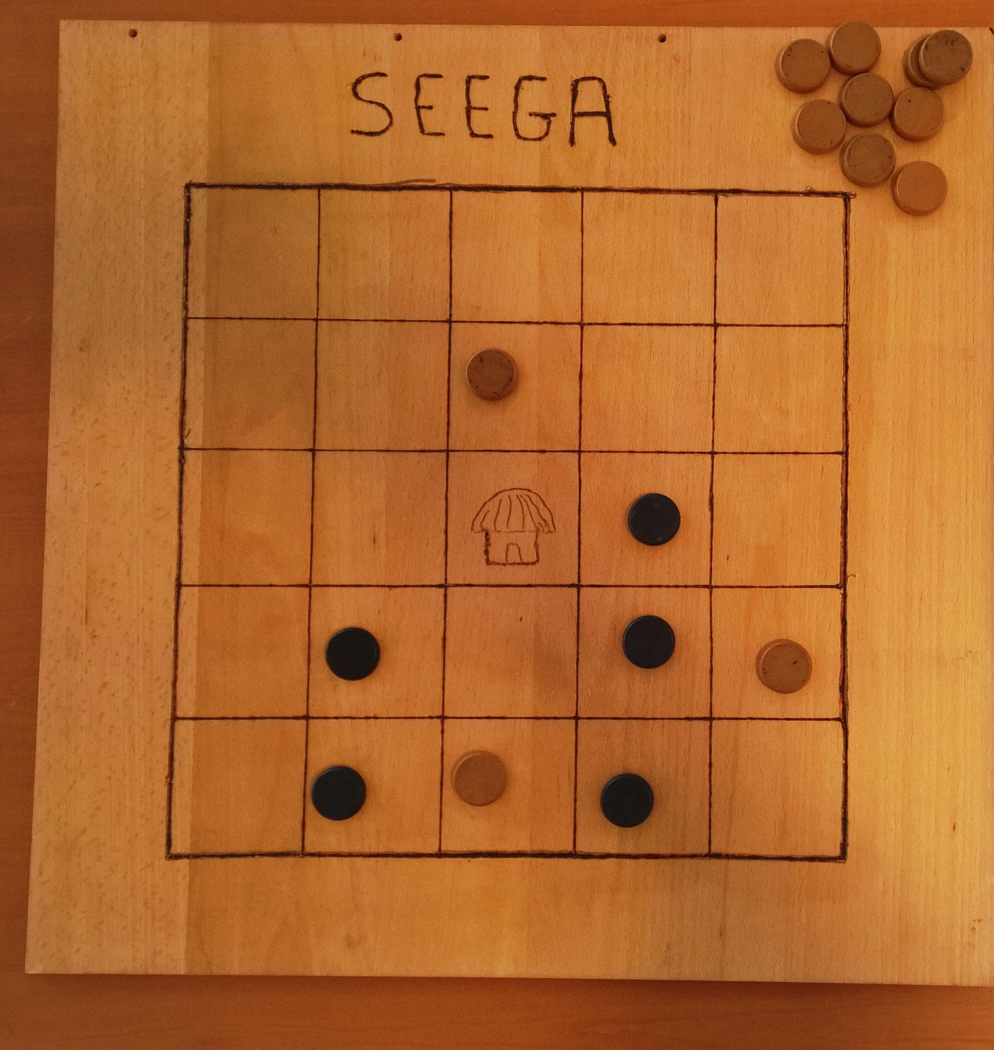 jeu de capture par encadrement, le Seega originaire d'Egypte, joué en Somalie