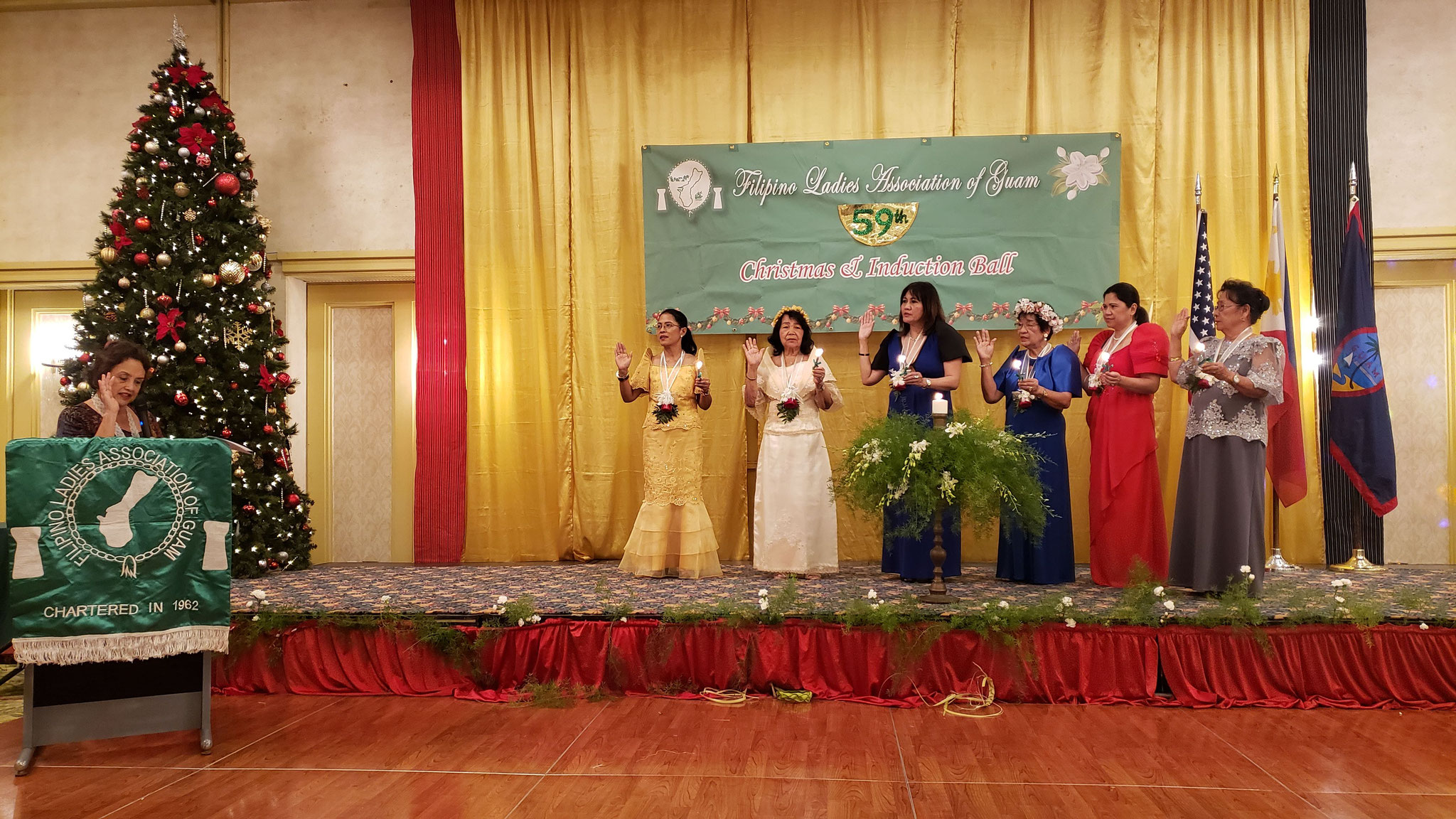 Guam Governor Lourdes Leon Guerrero (at podium) administers the oath of the 2020 executive officers of the Filipino Ladies Association of Guam during their 59th Induction and Christmas Ball. (Photo: PCG Agana)