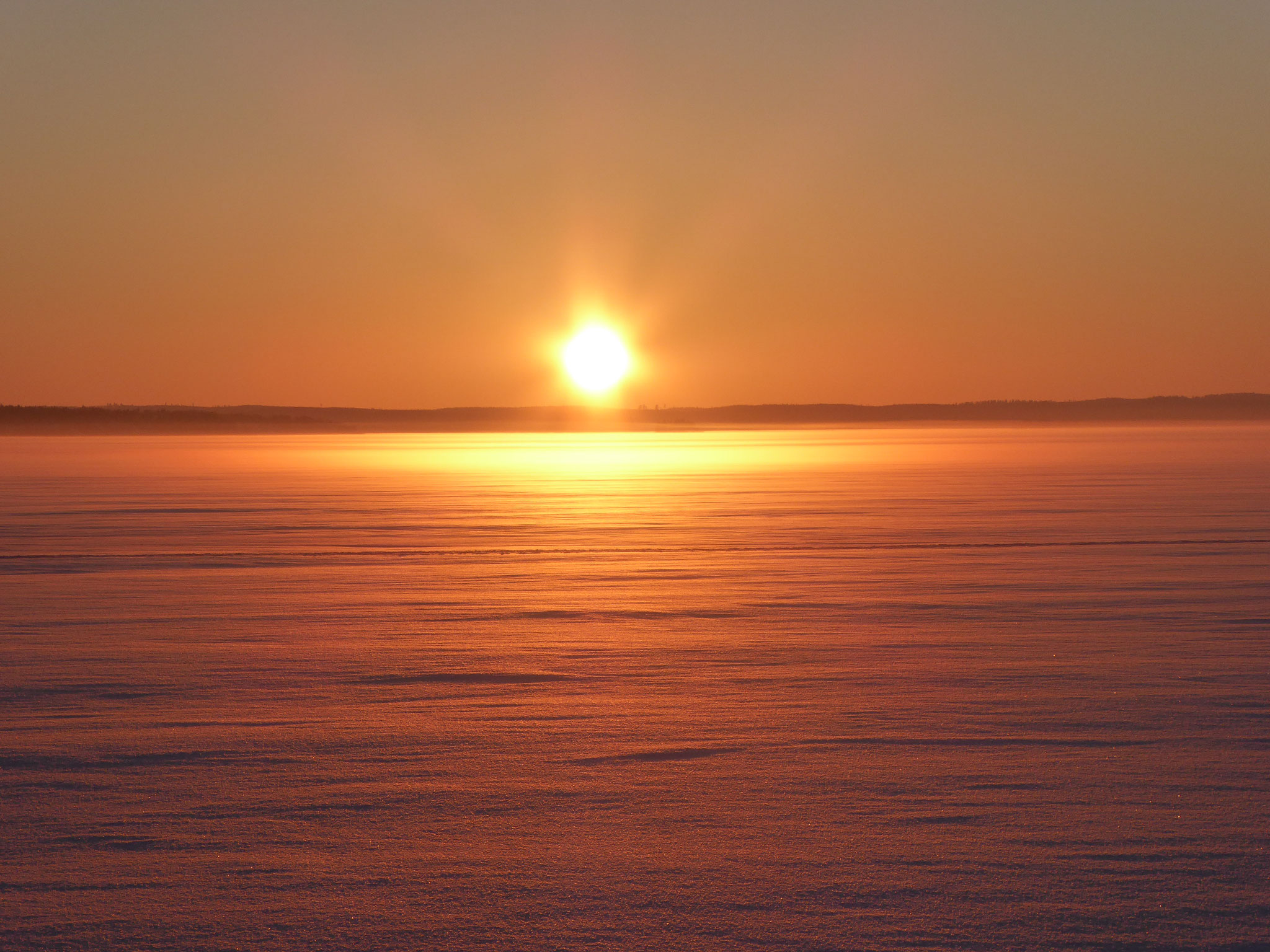 Amazing sunsets at frozen Lake Päijänne near the house