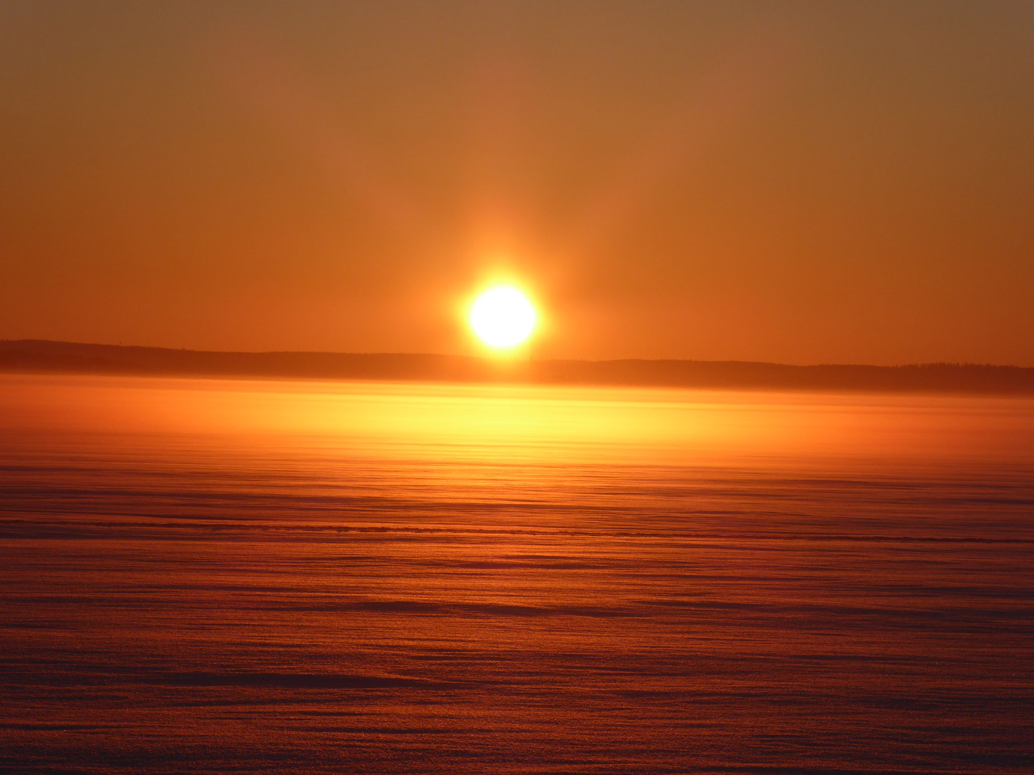Amazing sunsets at frozen Lake Päijänne near the house ...