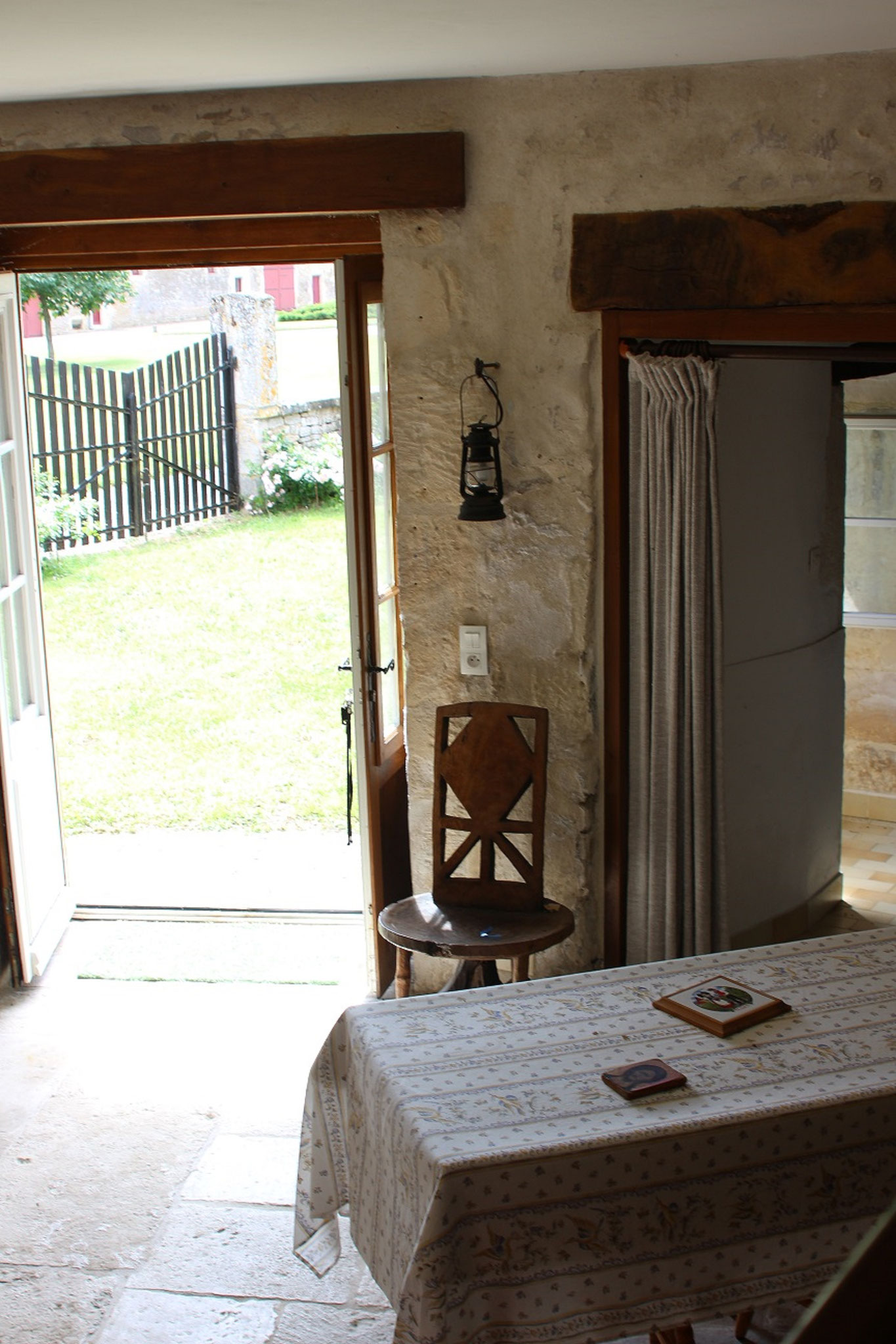 In the tower, the living room, dining area on the ground floor, overlooking the garden
