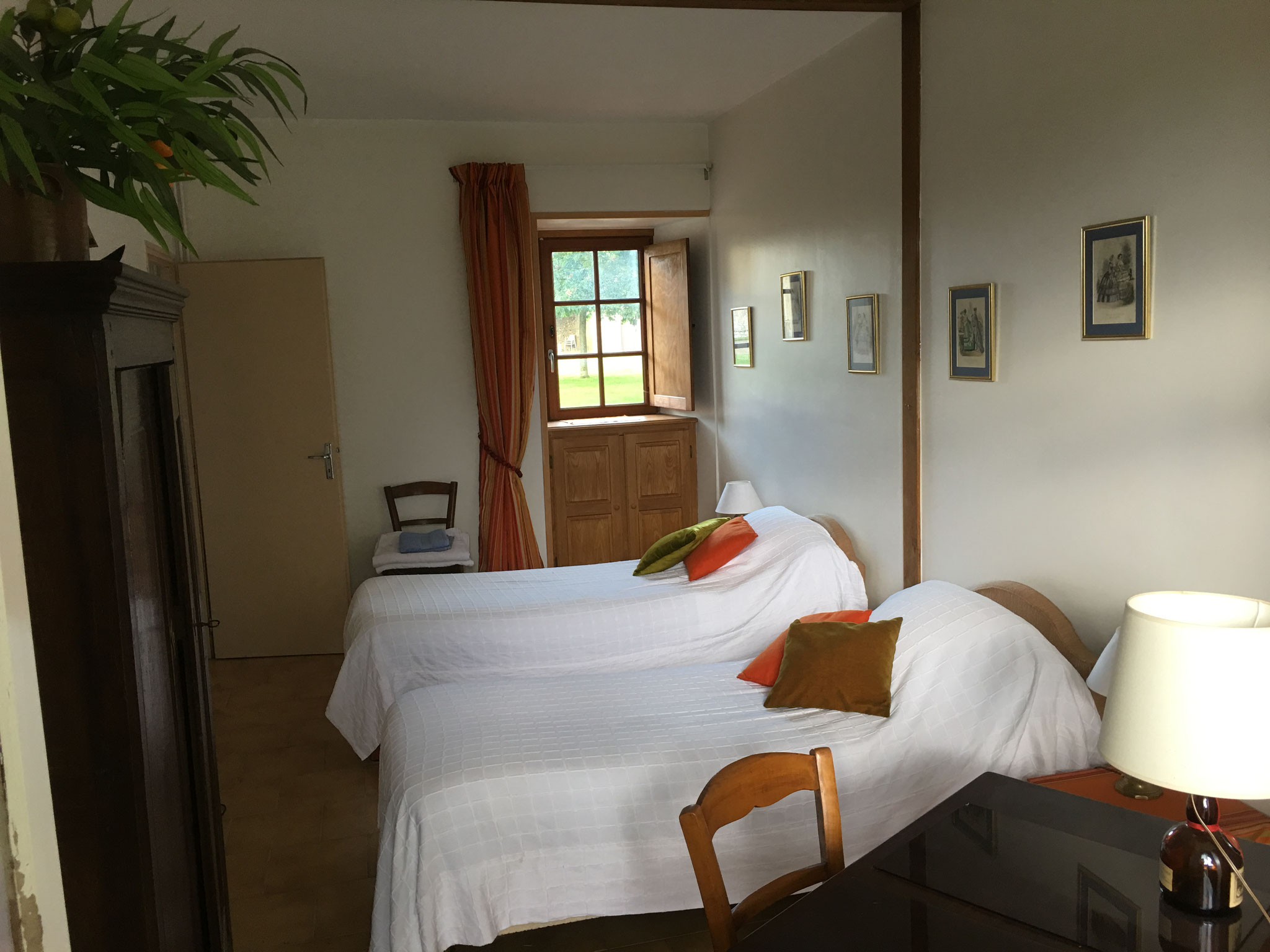 Twin bedroom on the ground floor, view towards the courtyard of the chateau