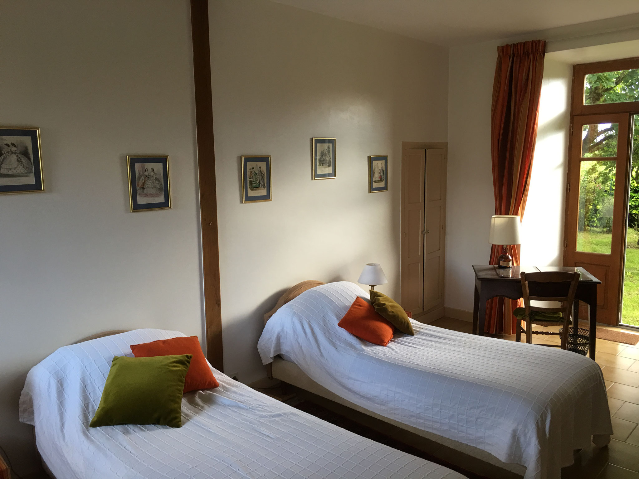 Room with 2 beds on the ground floor, from the entrance to the room