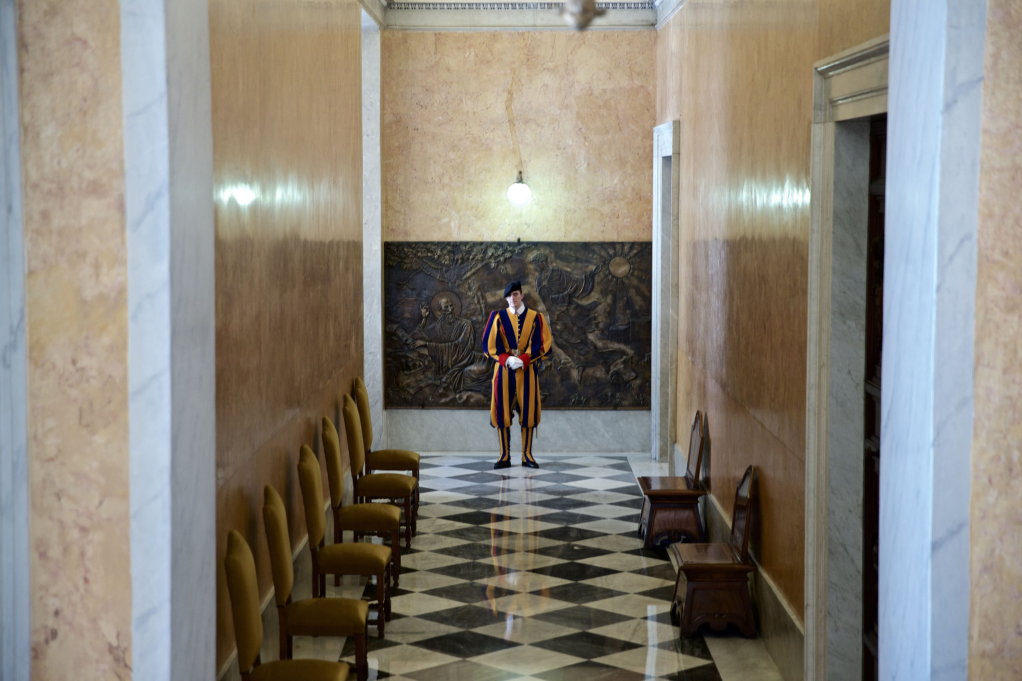 A Swiss Guard during his service in the Papal Palace.