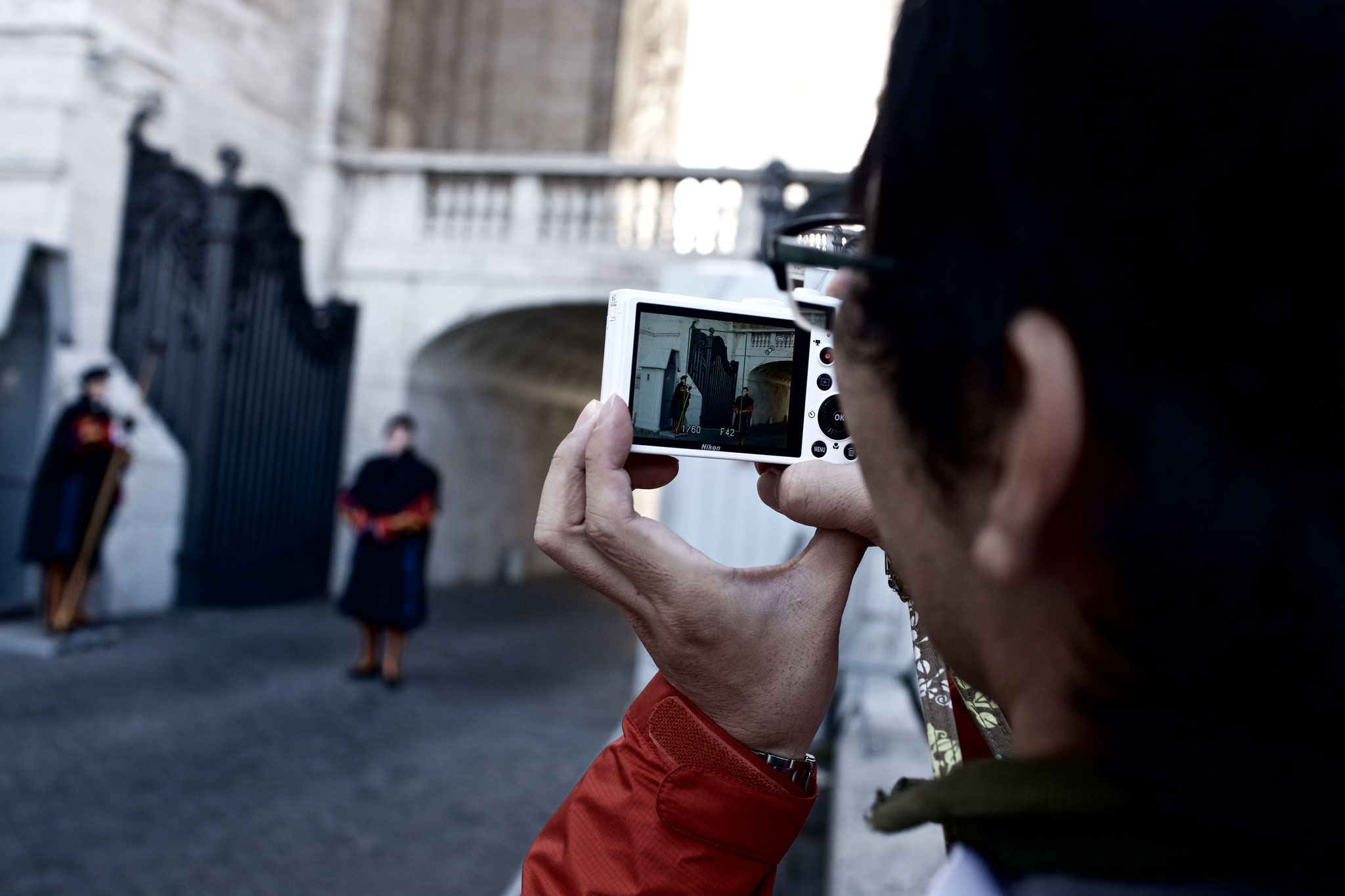 Guards being photographed by a tourist.