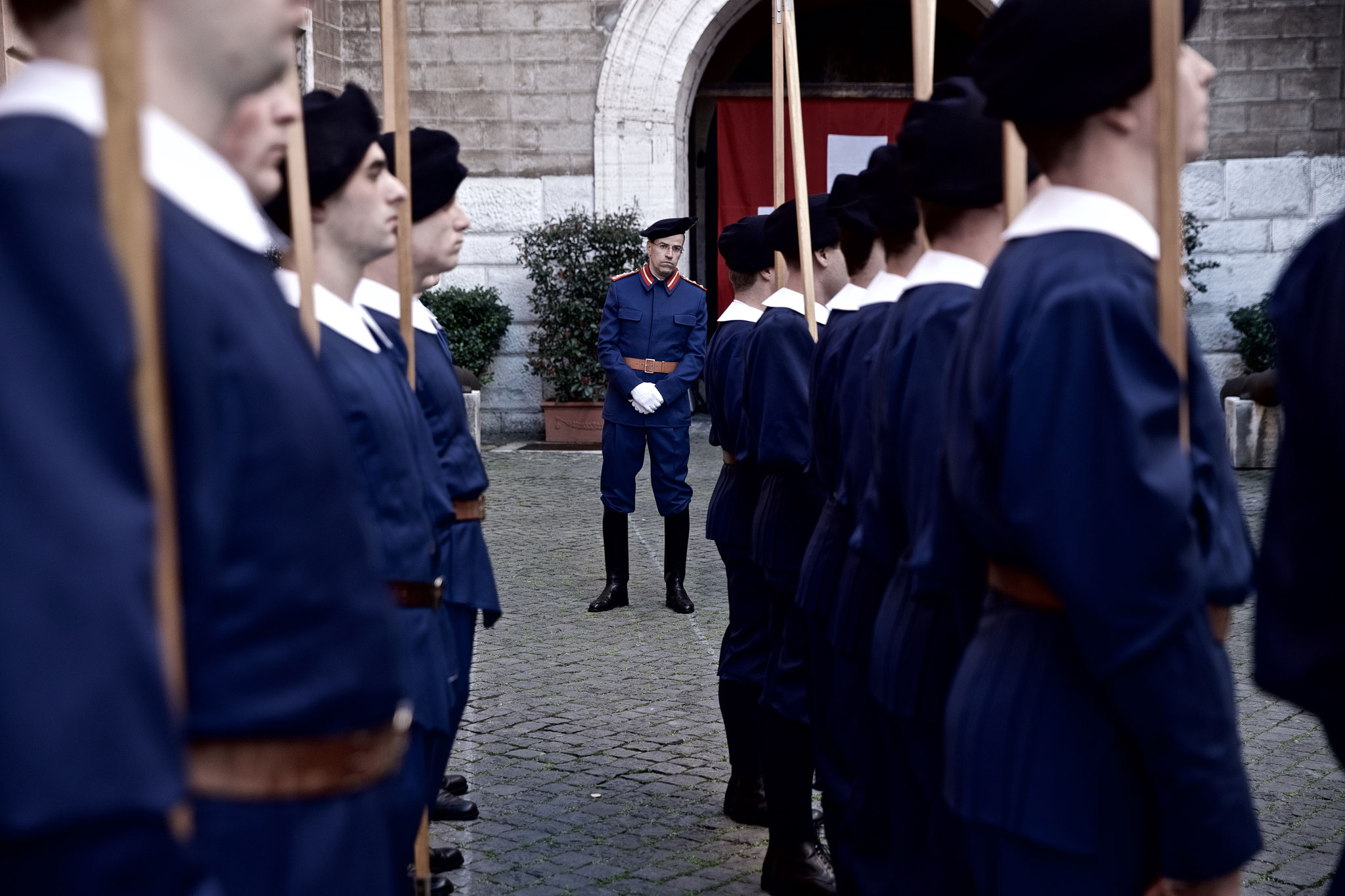 The commander inspects the uniforms in the court of the quarters before final exam.