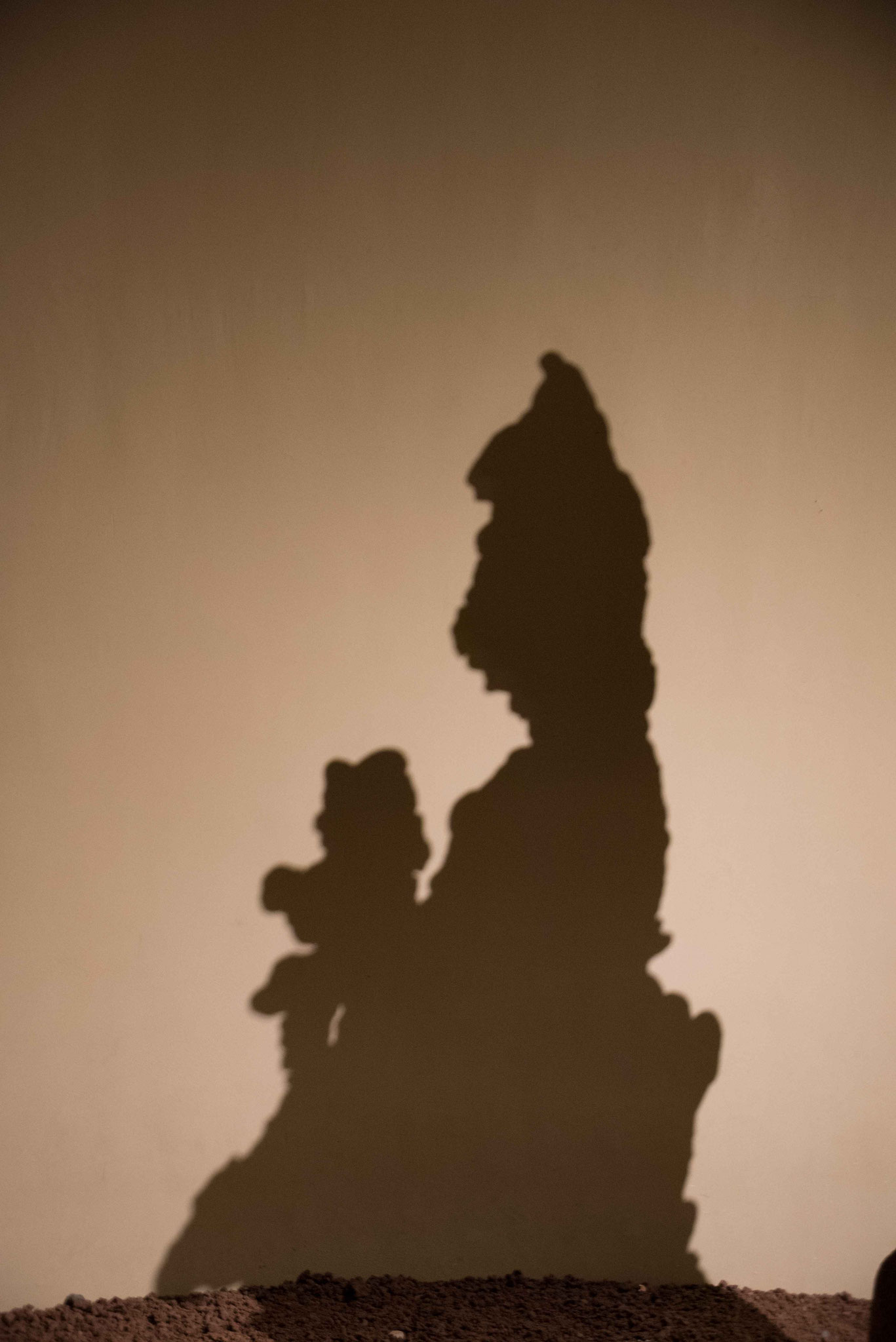 Schatten einer Steinfigur
