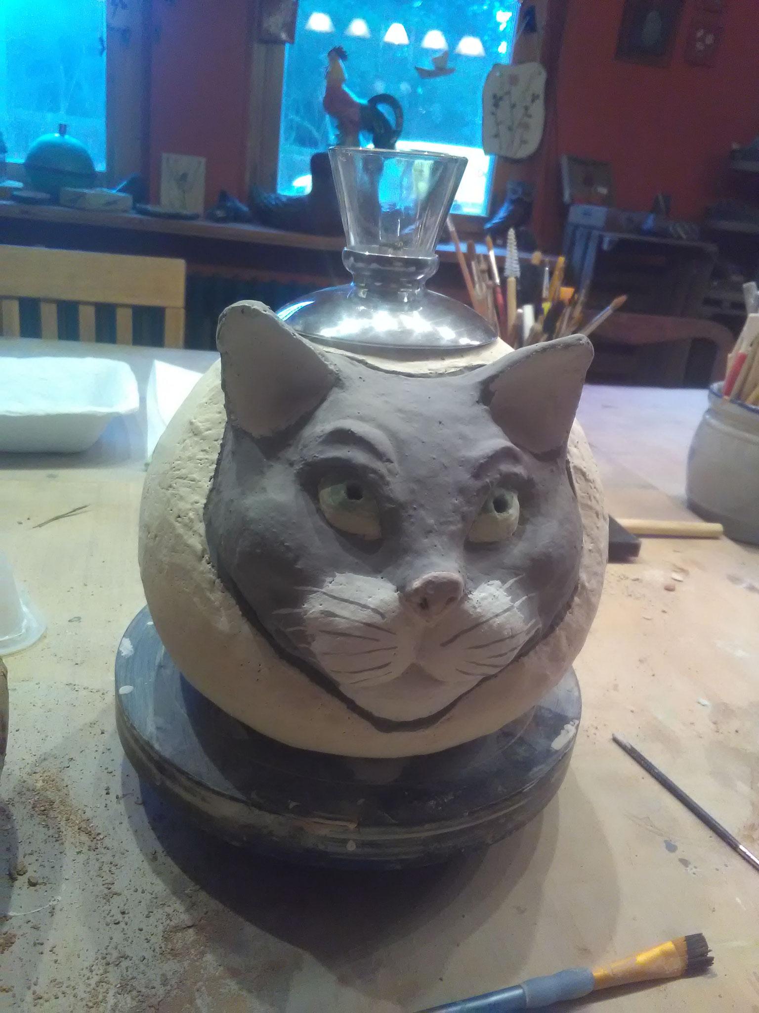 Öllampe mit Katzengesicht in Arbeit....